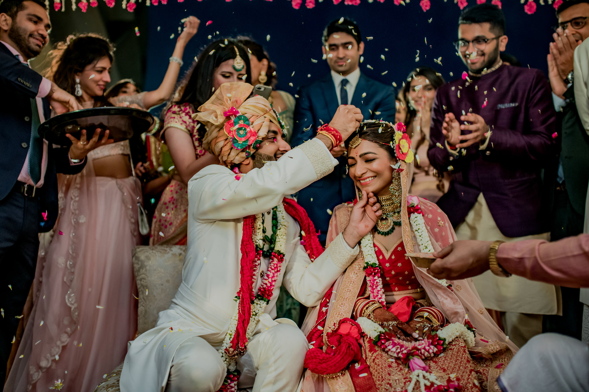 Groom blesses bride during ceremony - photo by Rimi Sen