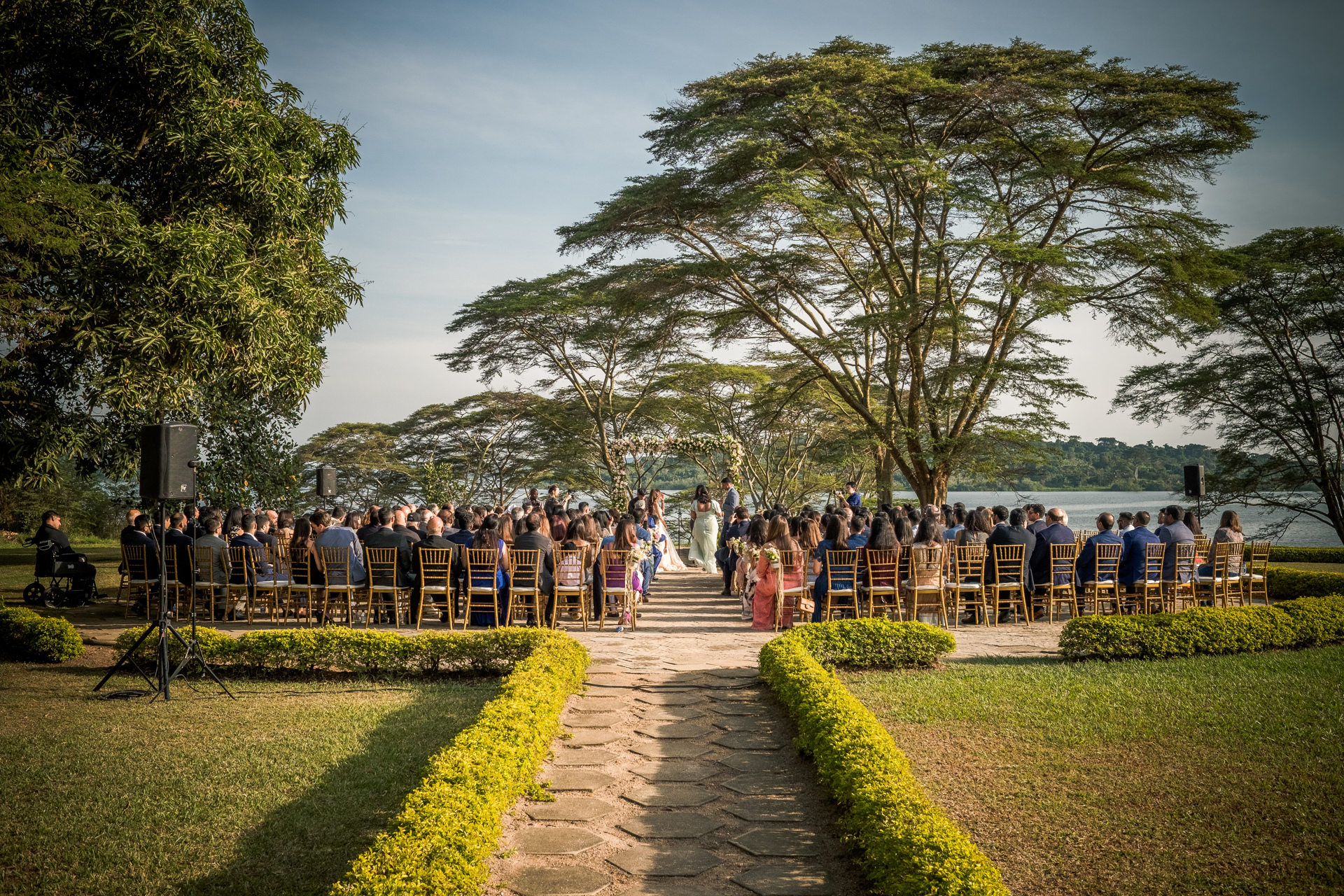 Garden wedding ceremony at waterfront - photo by Sephi Bergerson