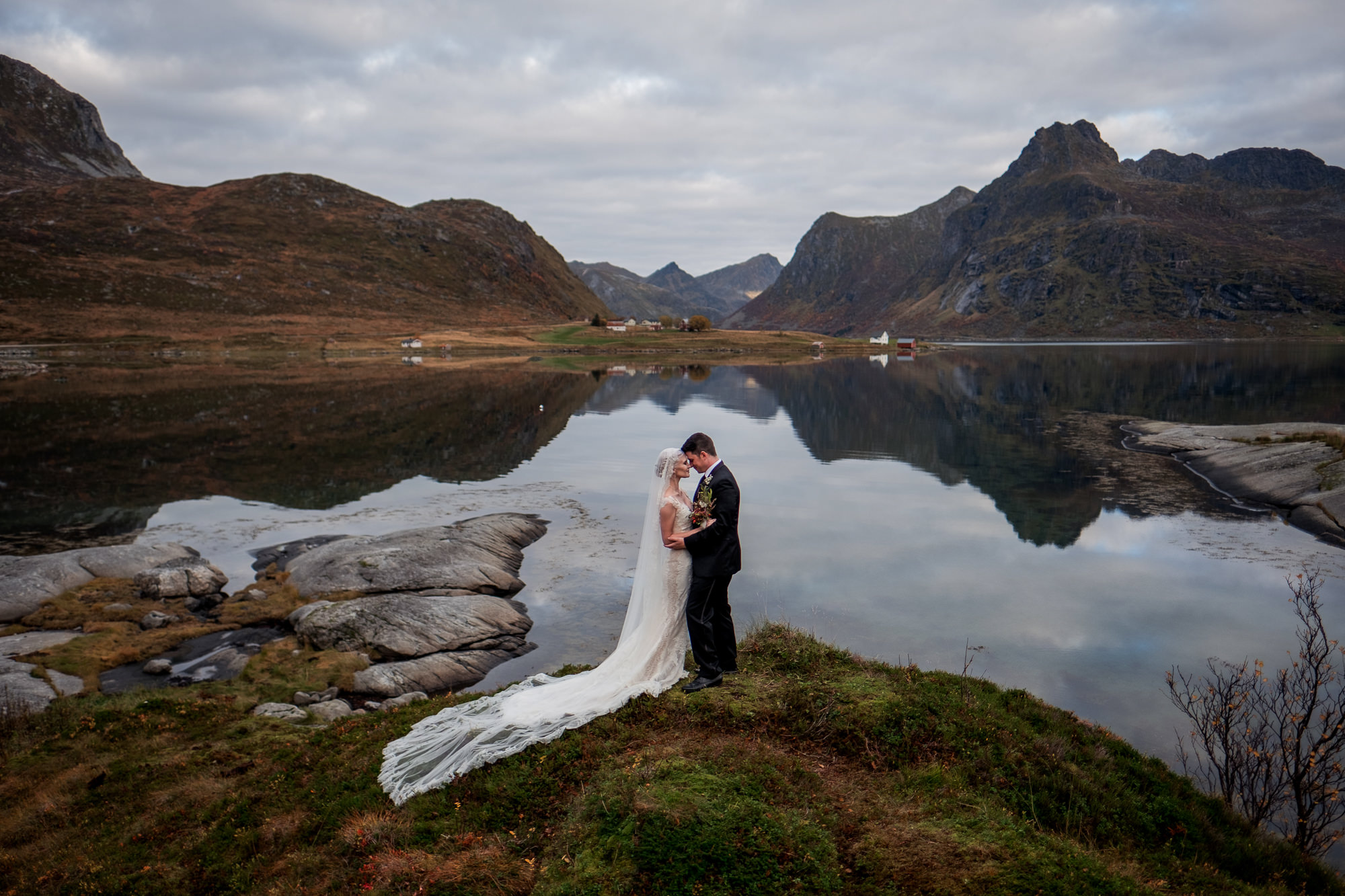 Portrait of bride and groom in breathtaking landscape of mountains and lake, by Nordica