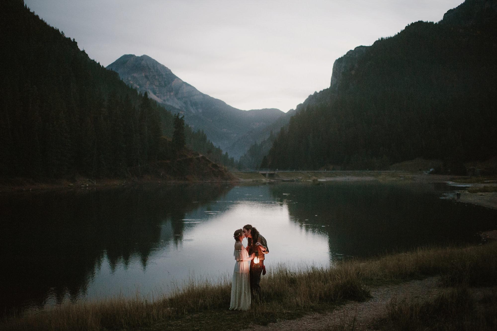 Lantern lit portrait of PNW couple at lake  - photo by Kristen Marie Parker