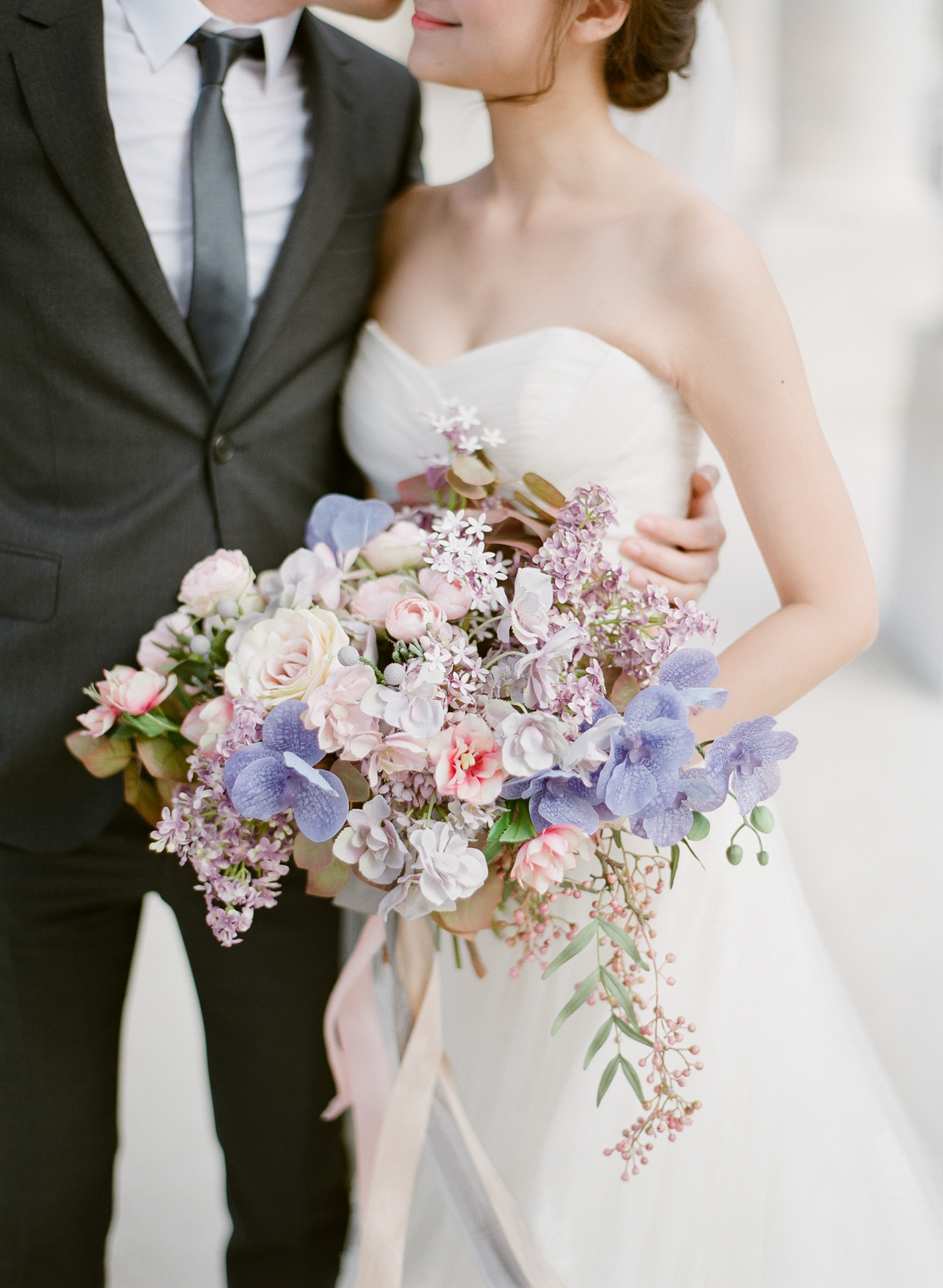 Large bouqet of roses, lilacs, and purple orchids  - Greg Finck Photography