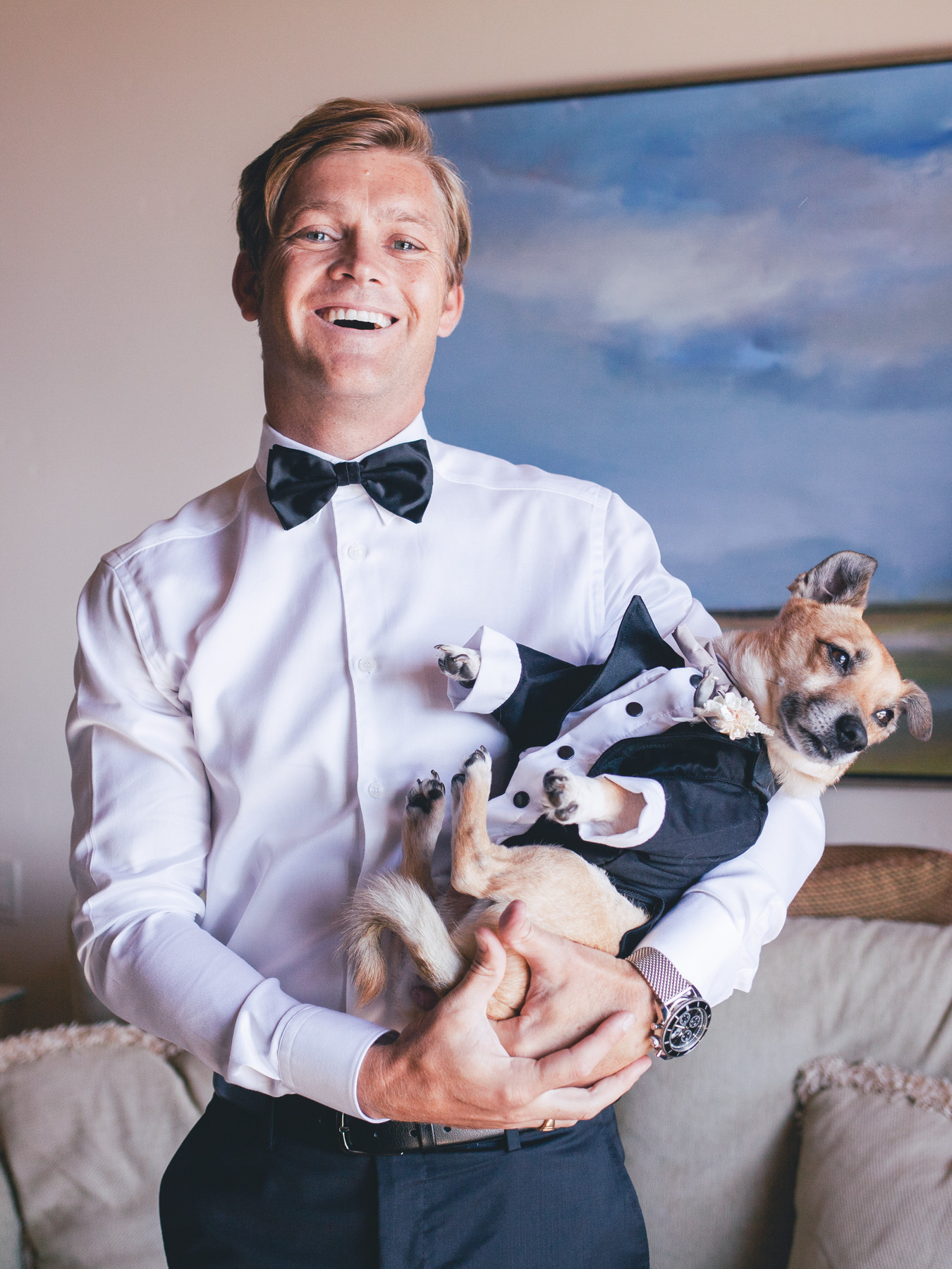 Portrait of groom and puppy in tuxedo by John and Joseph Photography