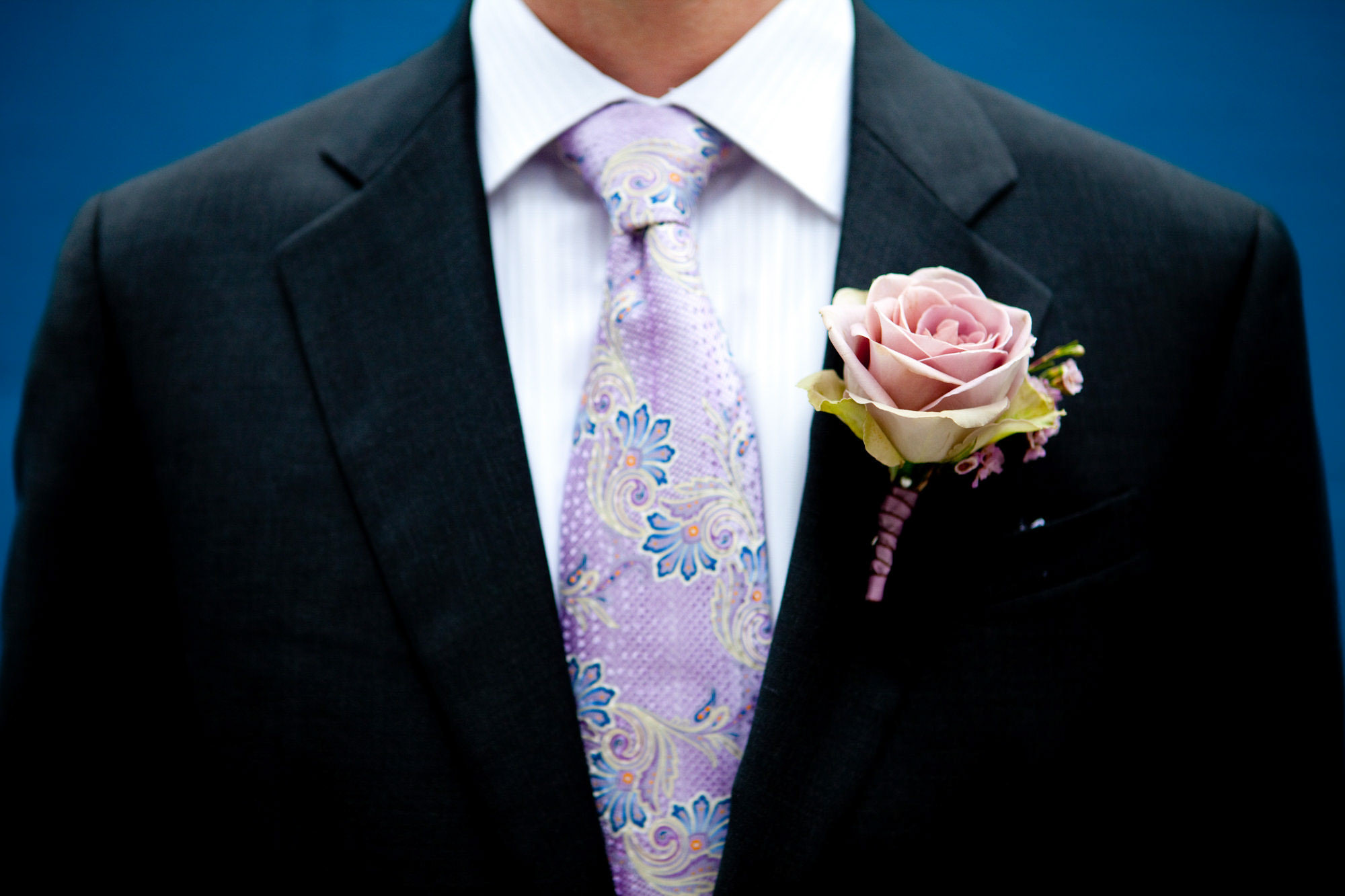 Groom with purple floral tie and pink rose boutonniere - La Vie Photography