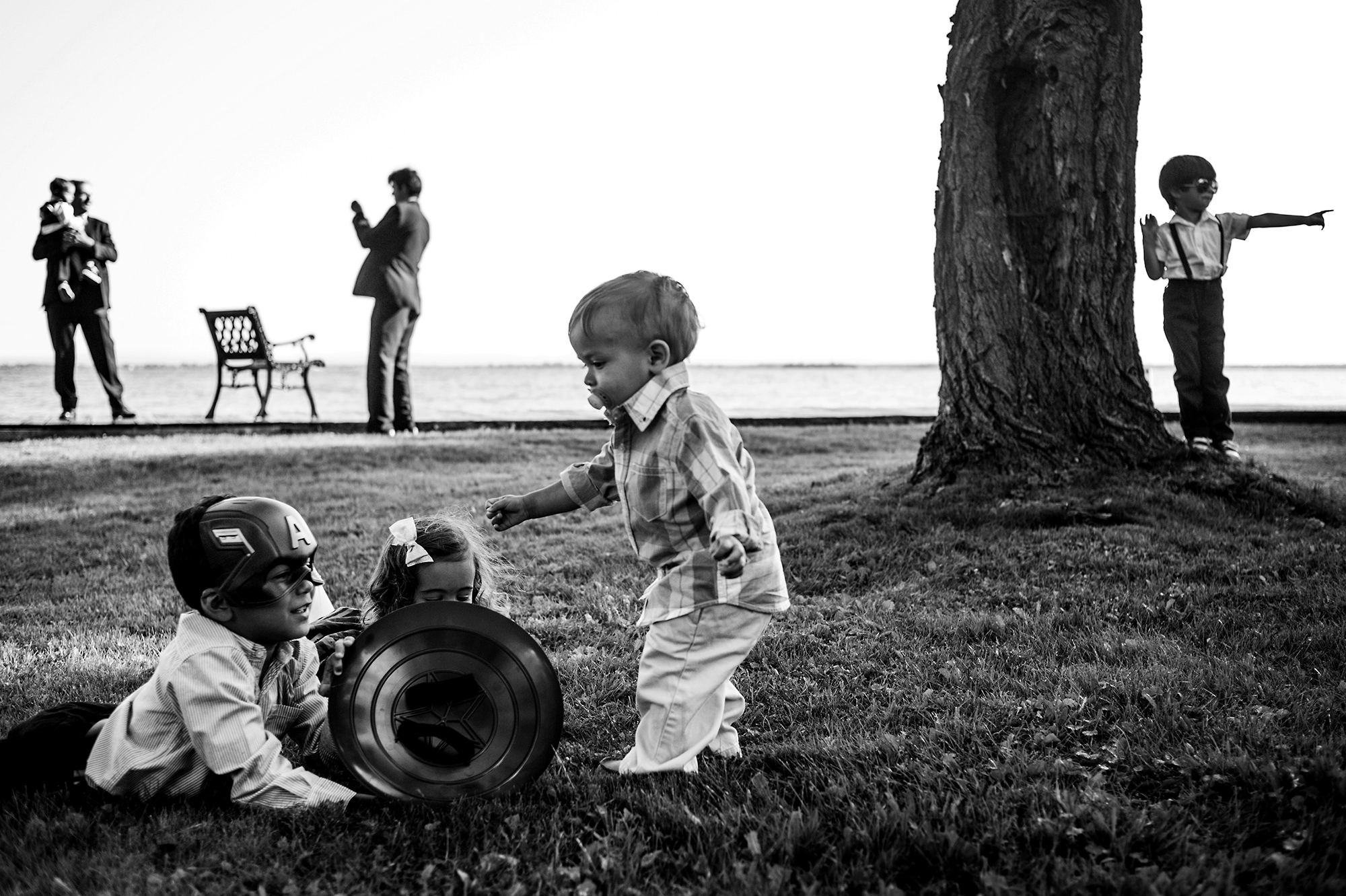 KIds playing with guests in the background - photo by Davina + Daniel