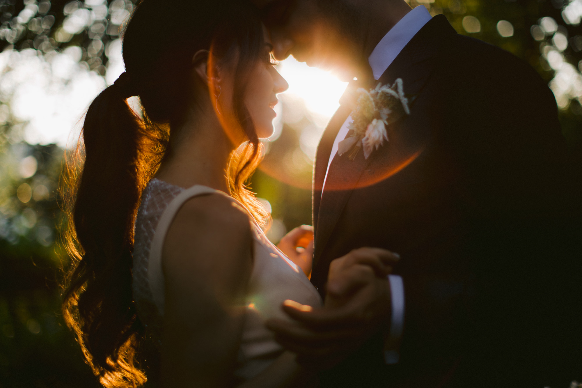 Lens flare couple portrait - photo by McClintock Photography Agency