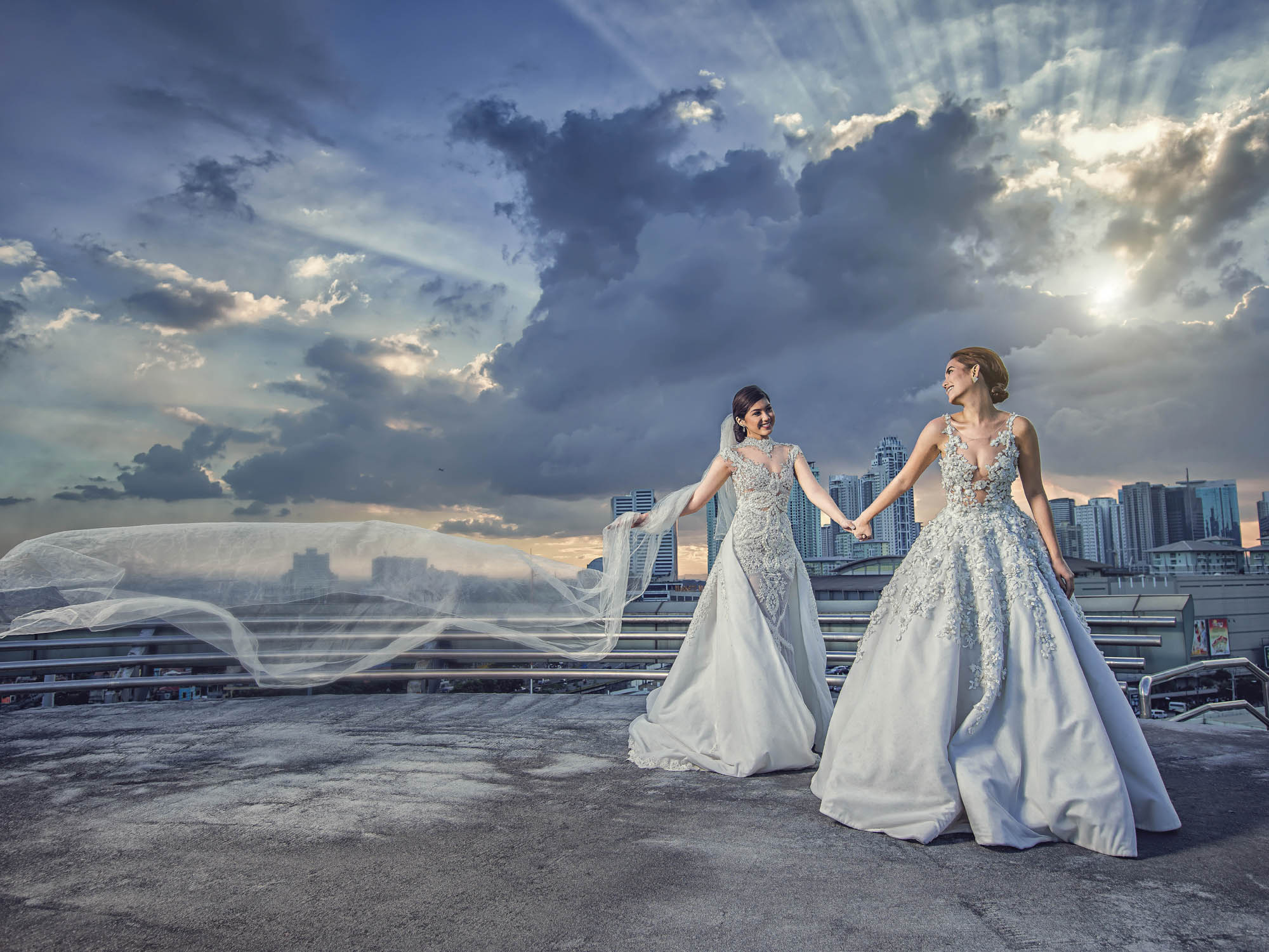 Brides in dramatic veil shot, by CM Leung