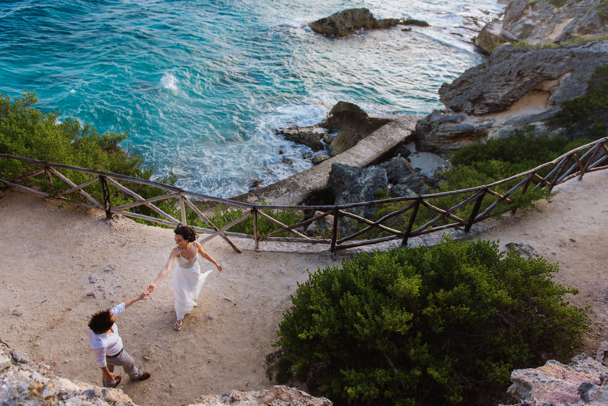 Brides dancing by cliff overlooking the sea, by Citlalli Rico