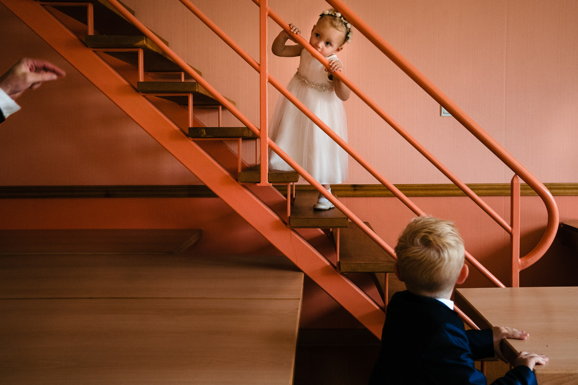 Little flower girl on stairs Yves Schepers Belgium wedding photographers