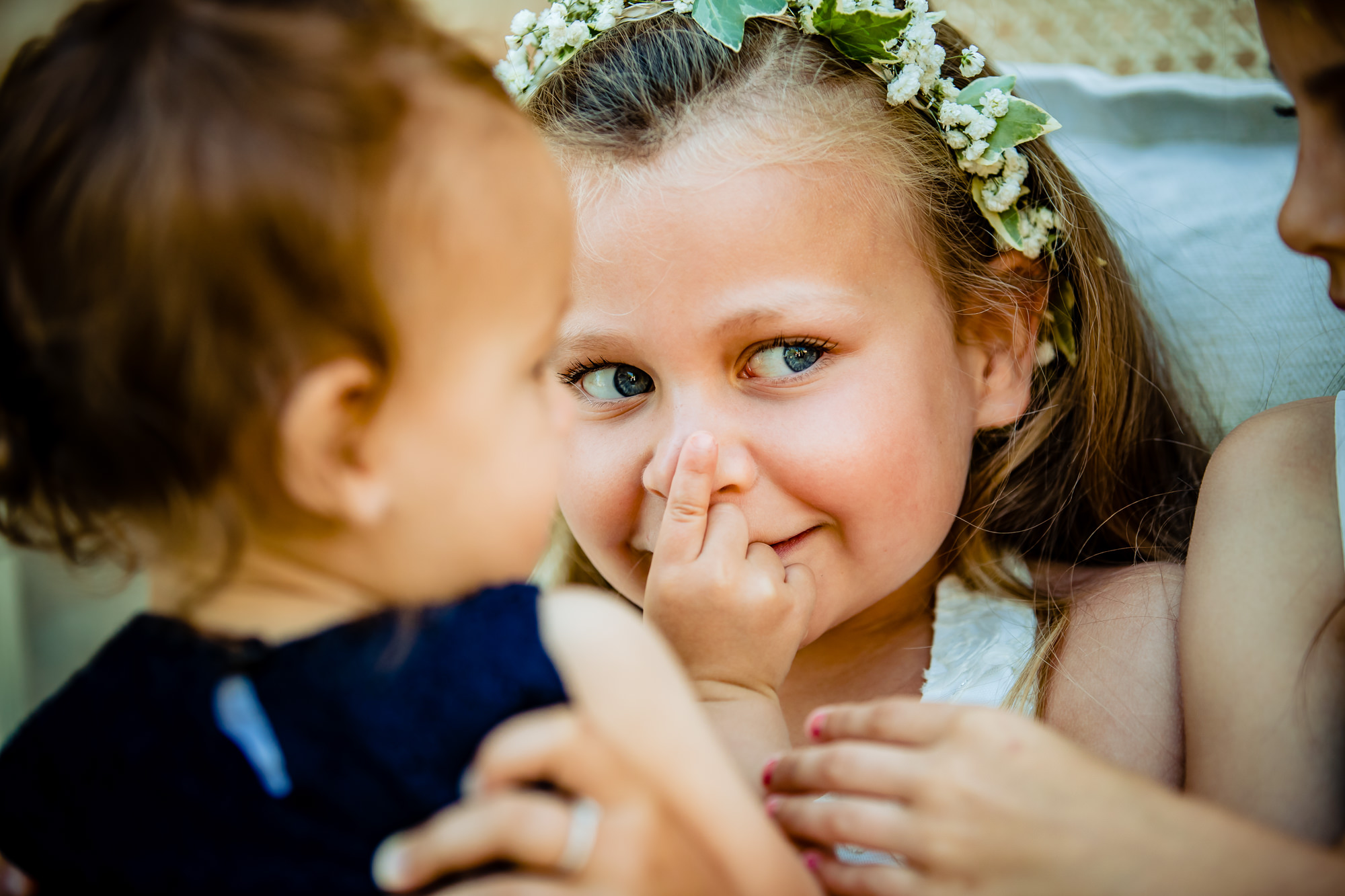 Cute little girl in flower crown pushes on her nose photo by Eppel Photography