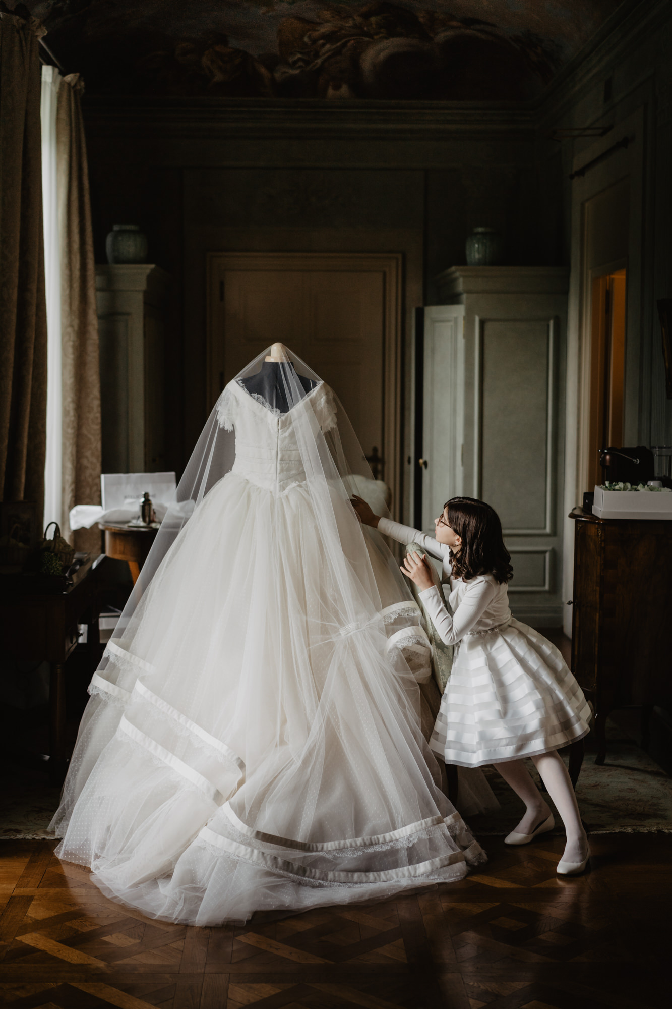 Child touching wedding gown photo by David Bastianoni