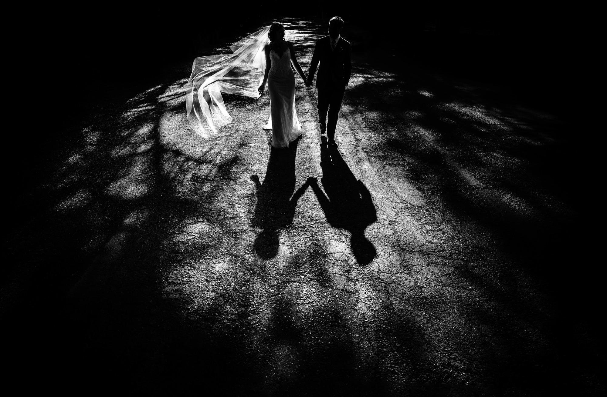 Long shadows of bride and groom Yves Schepers Belgium wedding photographers