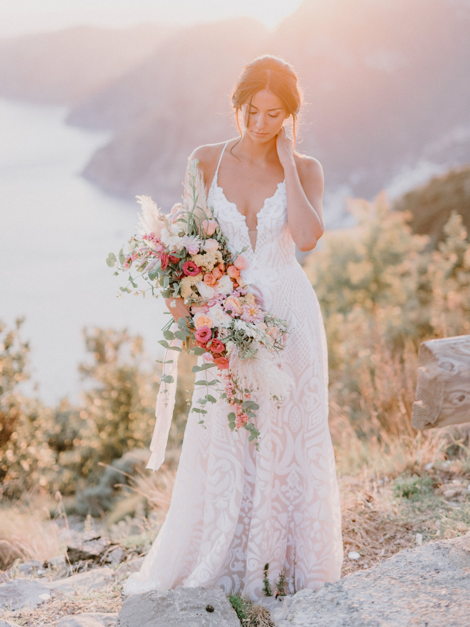 Romantic portrait of bride with lace dress and cascading bouquet - photo by Gianluca Adovasio Photography