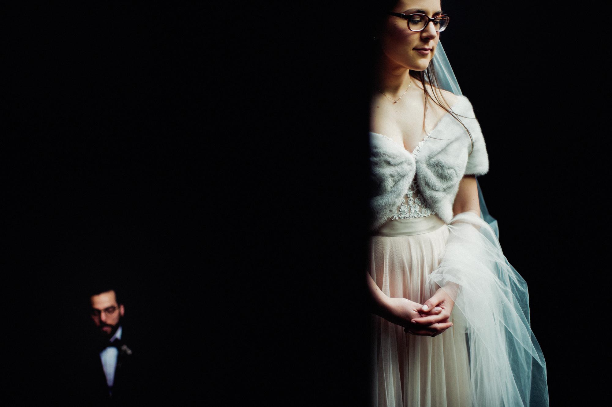 Creative wedding portrait of bride with fur shawl by Fer Juaristi
