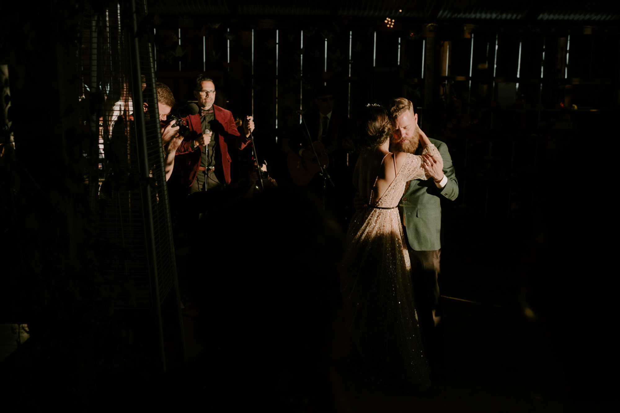 Low light first dance in rustic reception - photo by Kristen Marie Parker