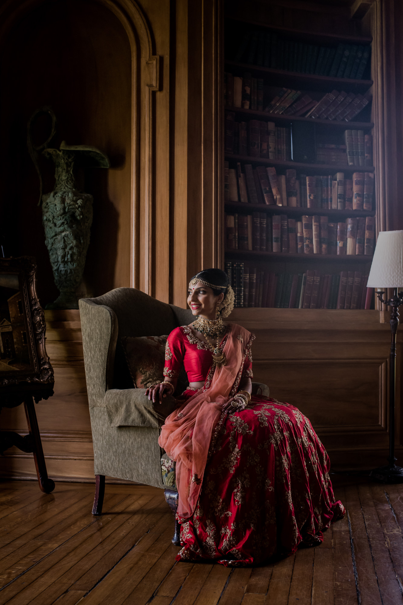 Indian bride sitting in library - photo by RImi Sen Photography