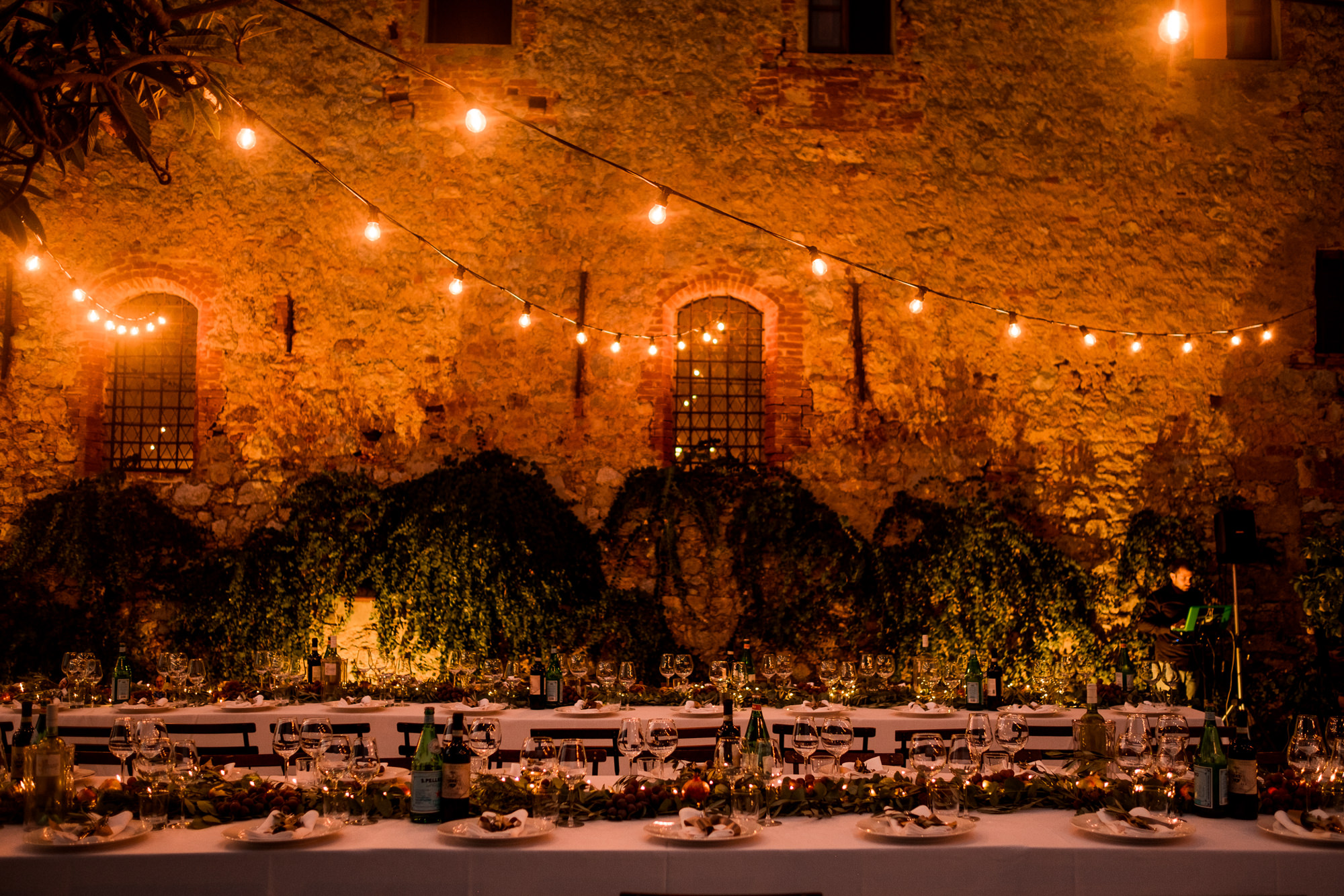 Low light reception tables and decor photo by Nordica Photography