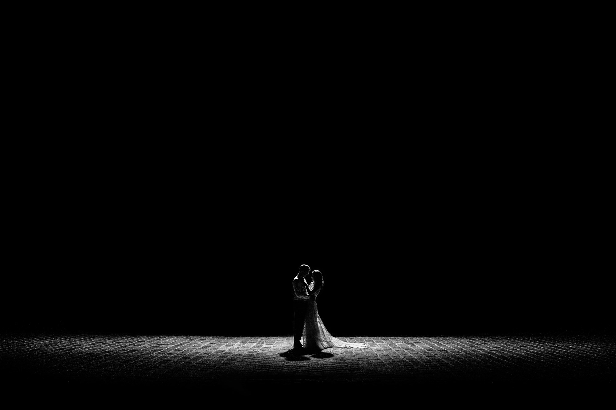 Low light spotlight for first dance Yves Schepers Belgium wedding photographers