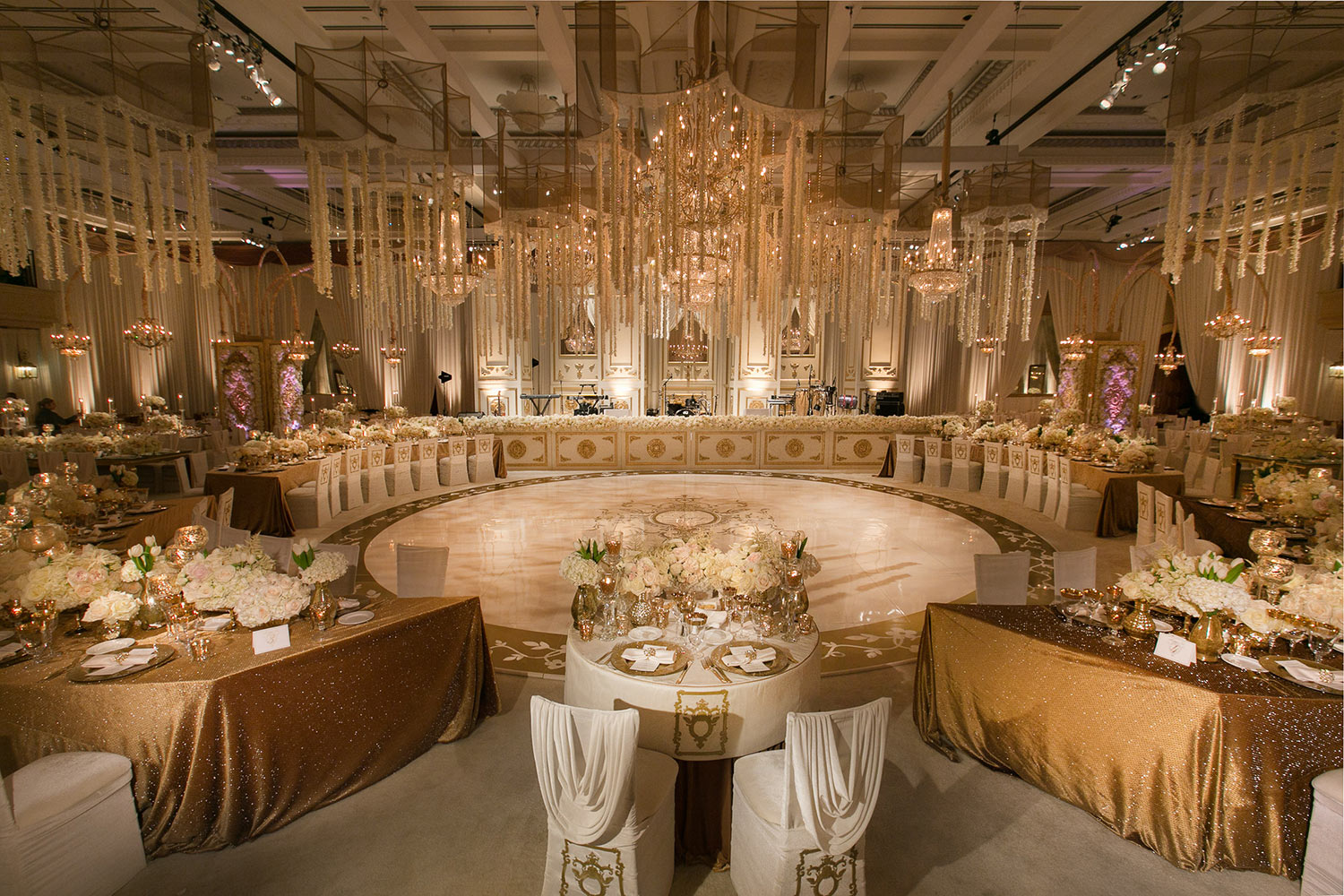 Luxurious ballroom reception setup in white and gold, by Callaway Gable