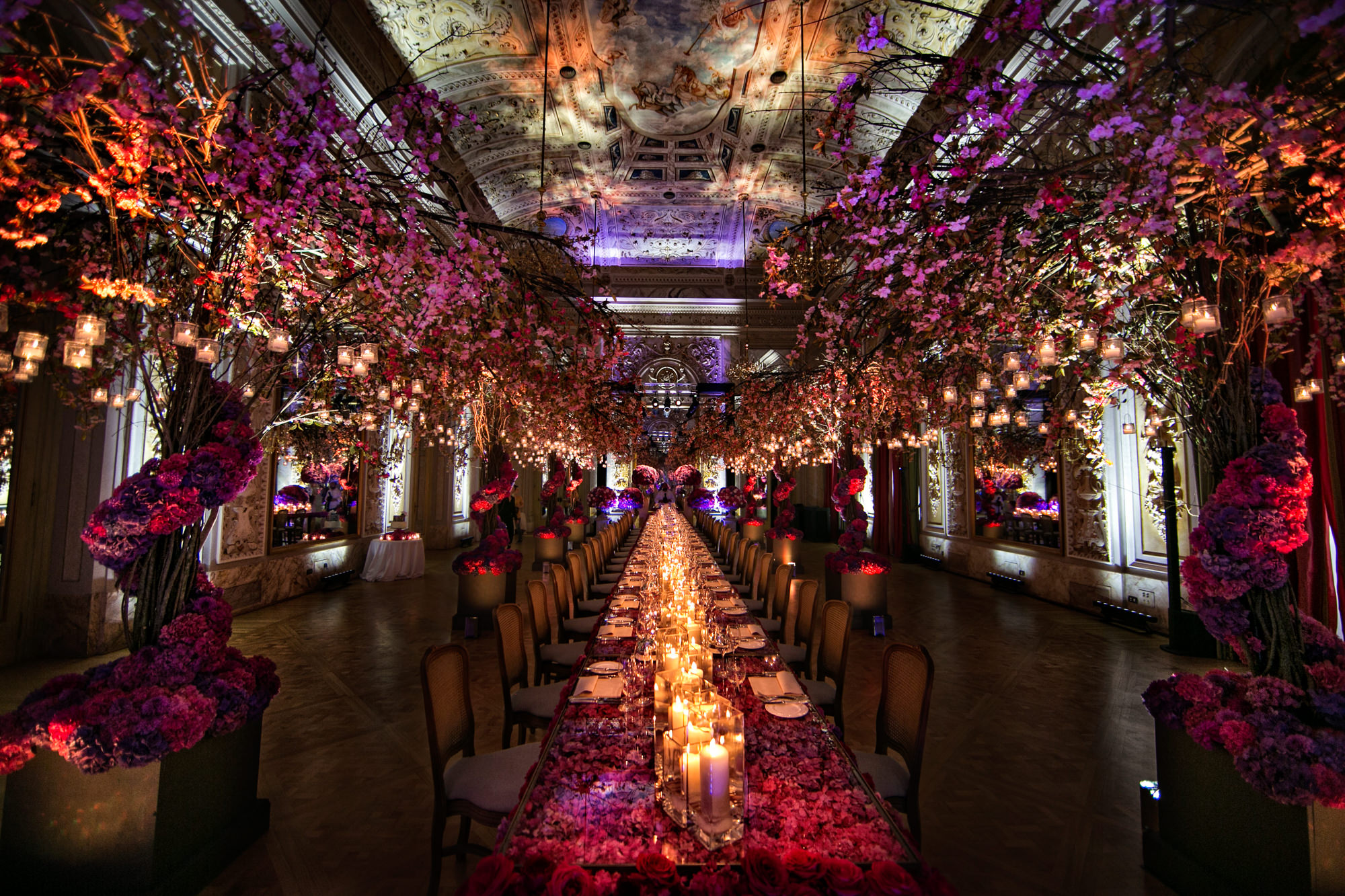 Luxury European wedding table elaborate floral decor pink lighting handpainted ceiling