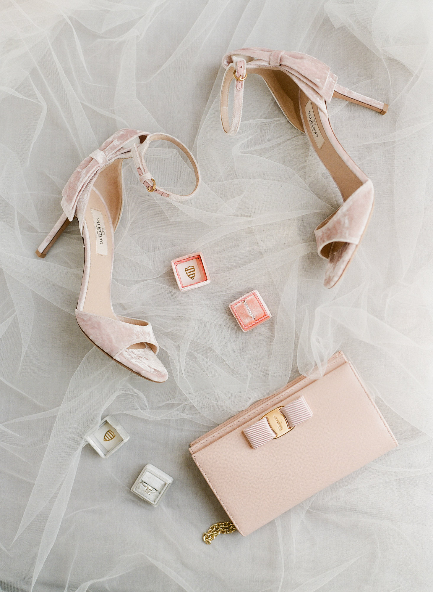 Flatlay of pink Velvet Valentino sandals and Ferragamo clutch - Greg Finck Photography