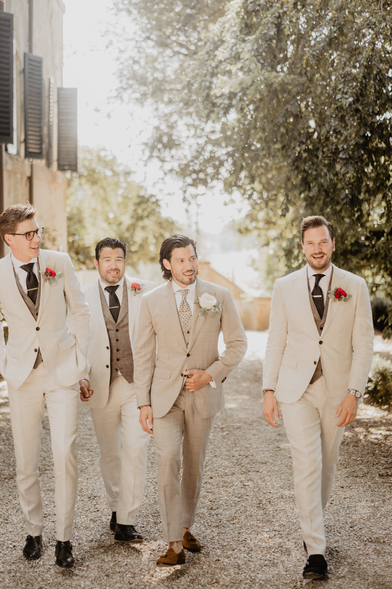Men's fashion groom party taupe suits brown ties, photo by David Bastianoni, Italy wedding photographer