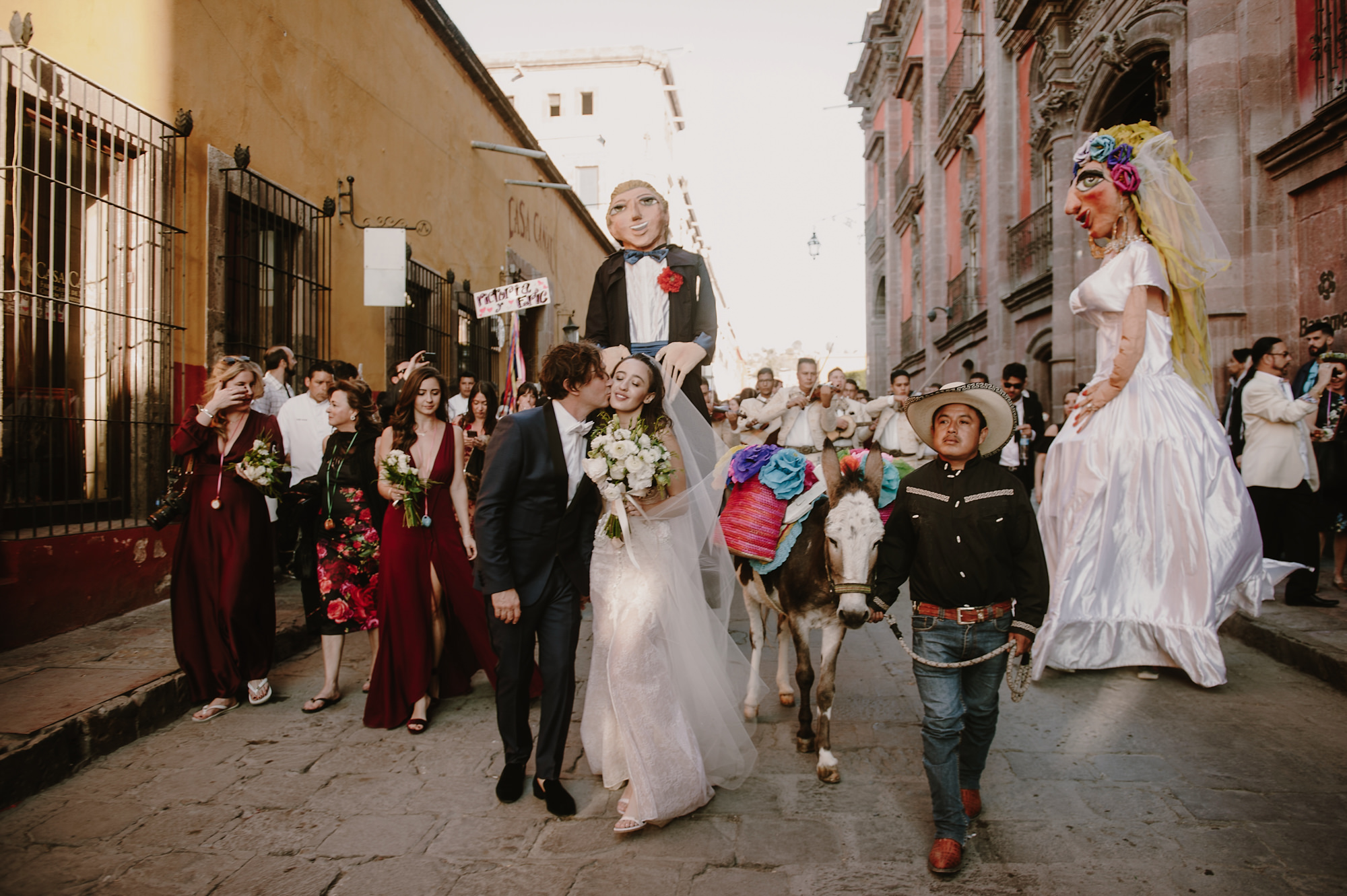 Mexican wedding recessional with large puppets - photo by Kristen Marie Parker
