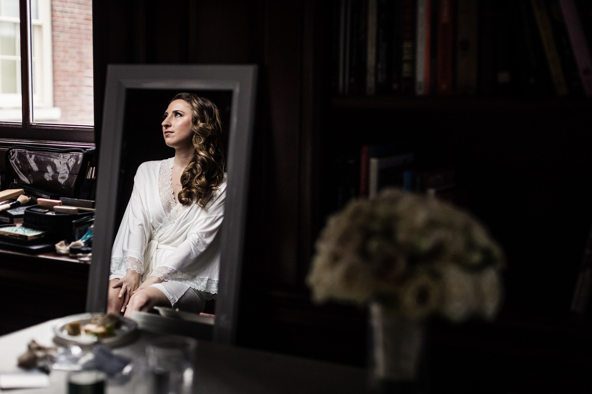 Reflection of bride in mirror by Jag Studios