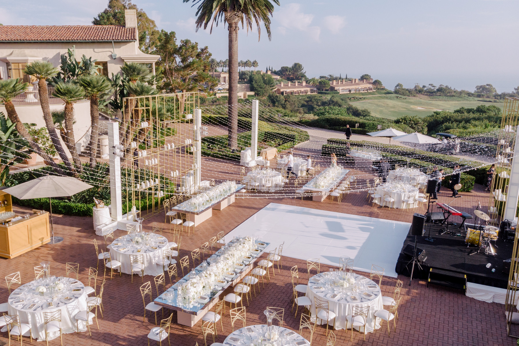 Pelican Hill outdoor reception site with white decor -John and Joseph Photography