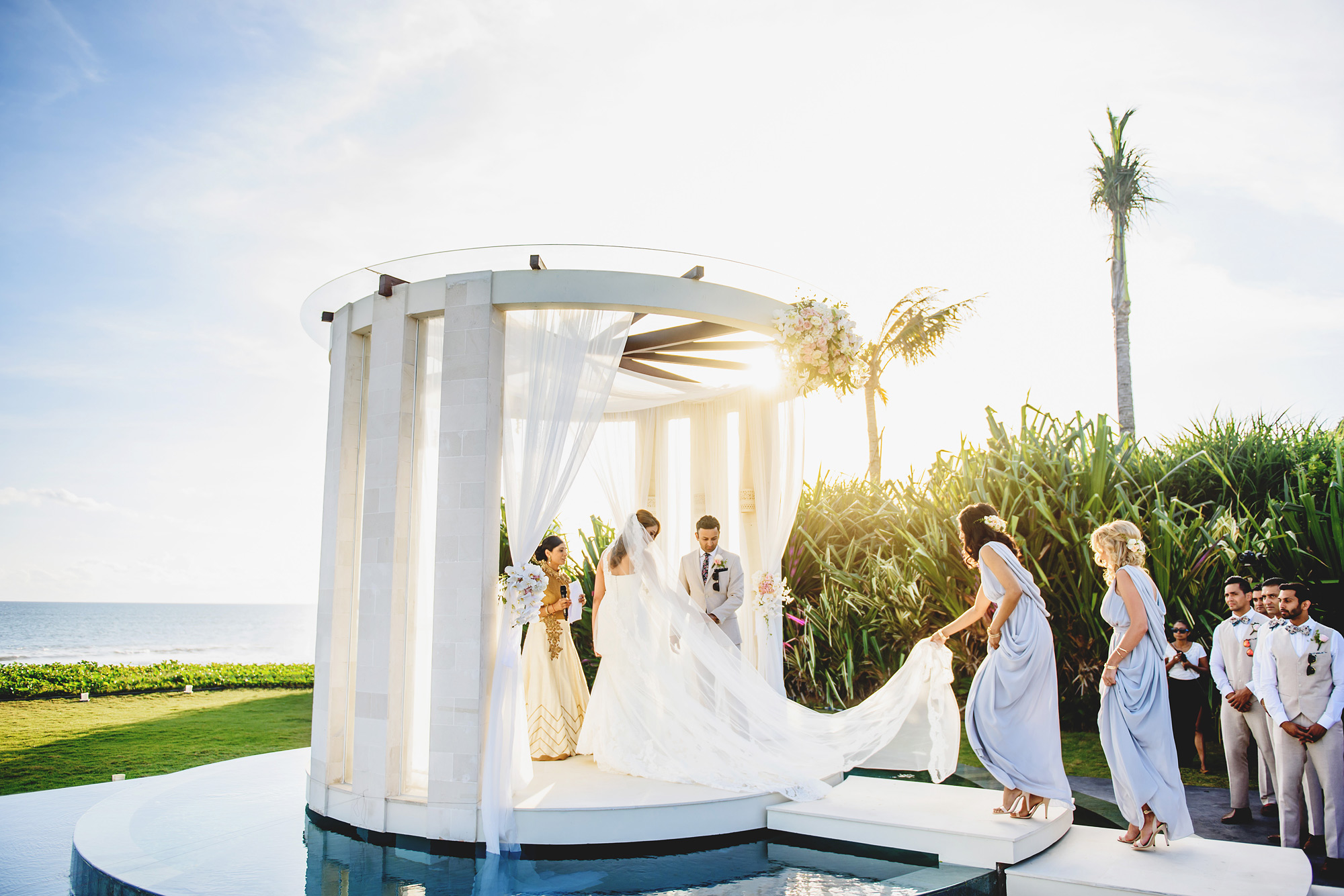 Couple in modern gazebo near beach - photo by Ross Harvey