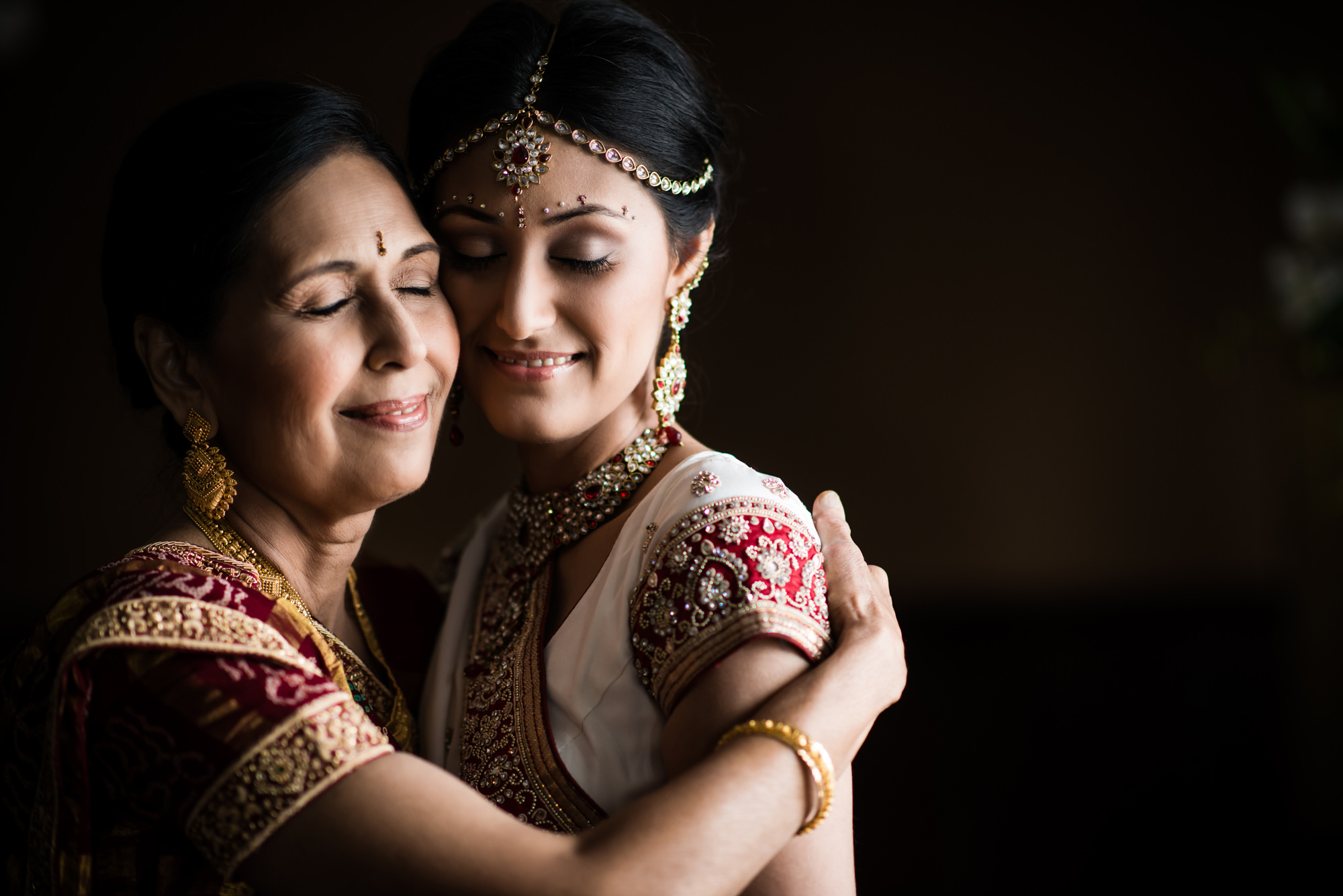 Indian mother and bride embrace photo by Cliff Mautner