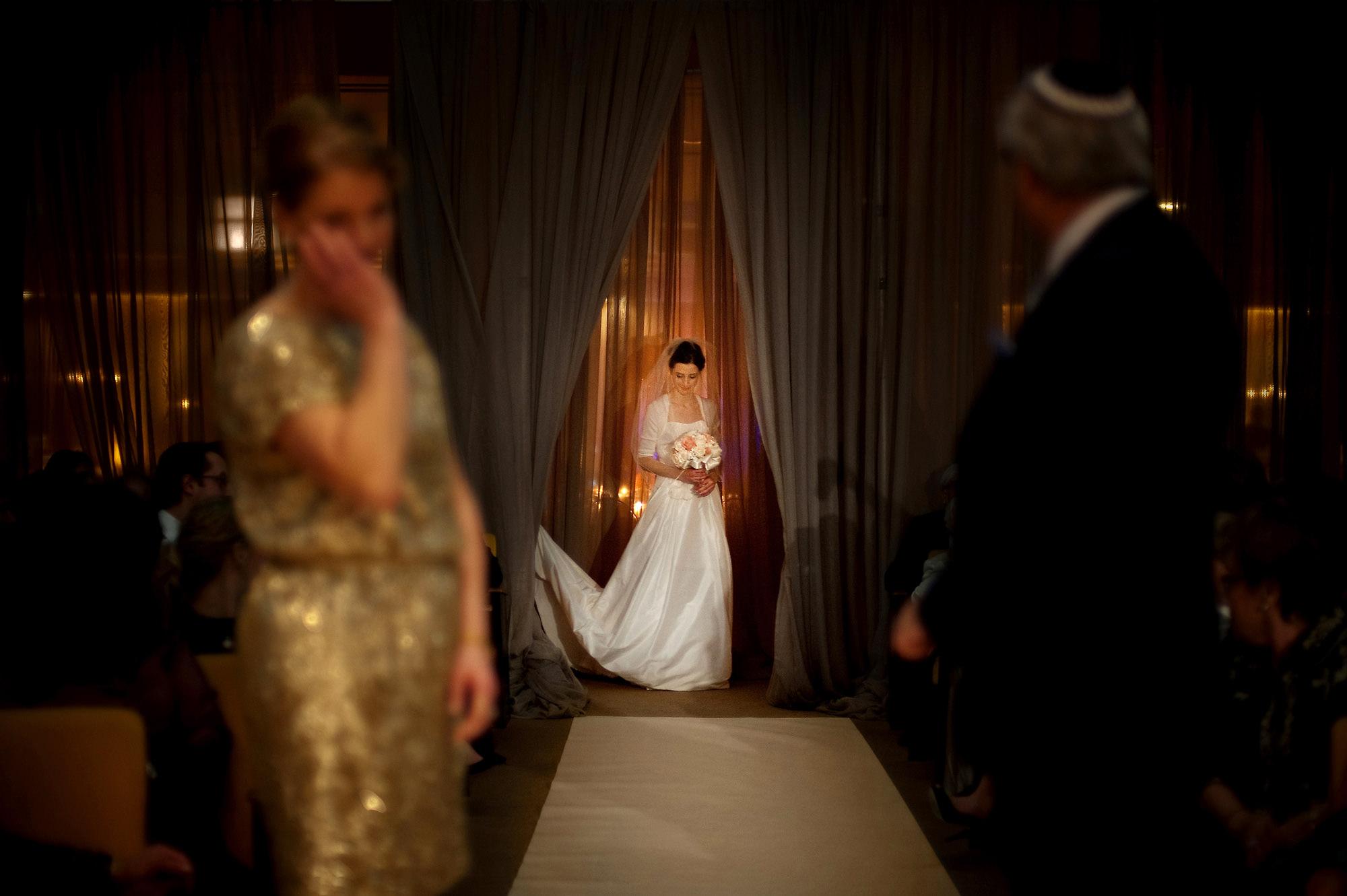 Mom of bride tears up - photo by Davina + Daniel