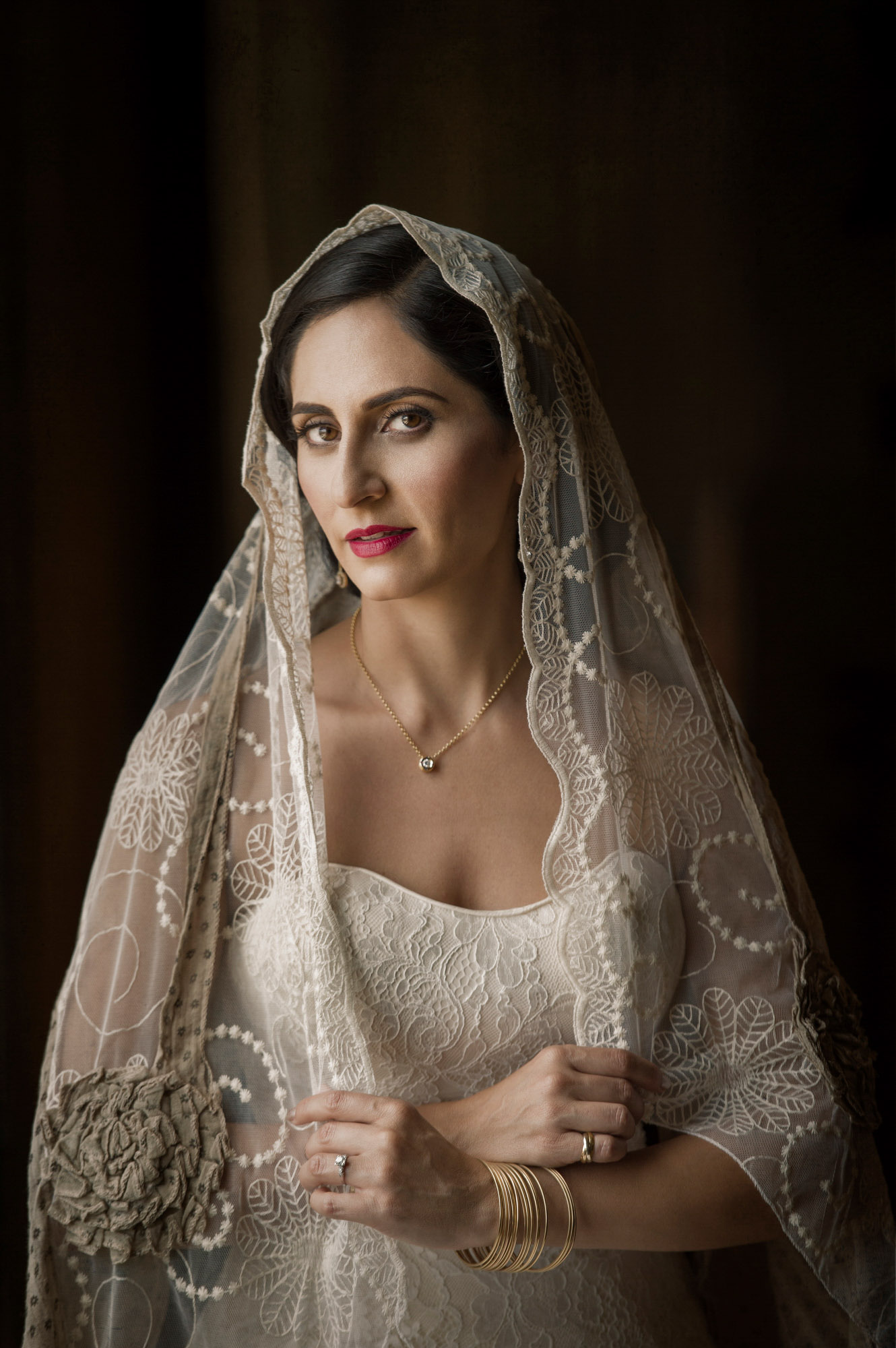 Classic portrait of bride in mantilla veil by Jerry Ghionis