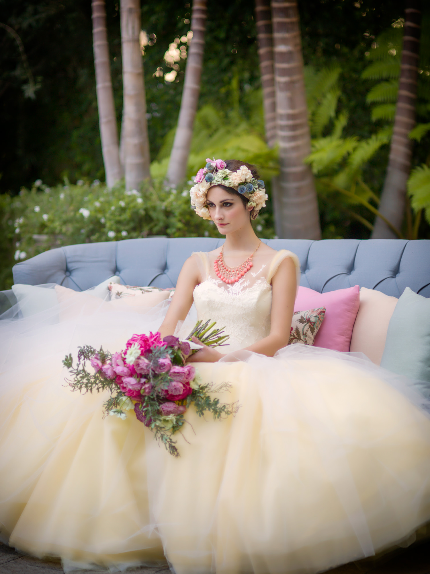 Bride with large floral crown and pink summer bouquet - photo by Roberto Valenzuela