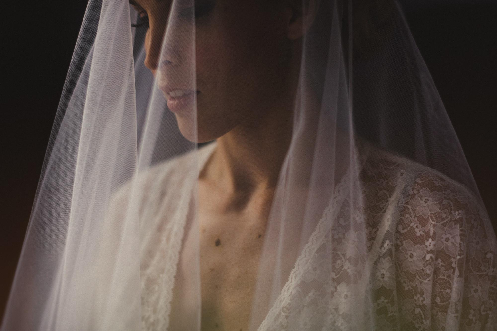 Romantic portrait of bride under veil by Fer Juaristi