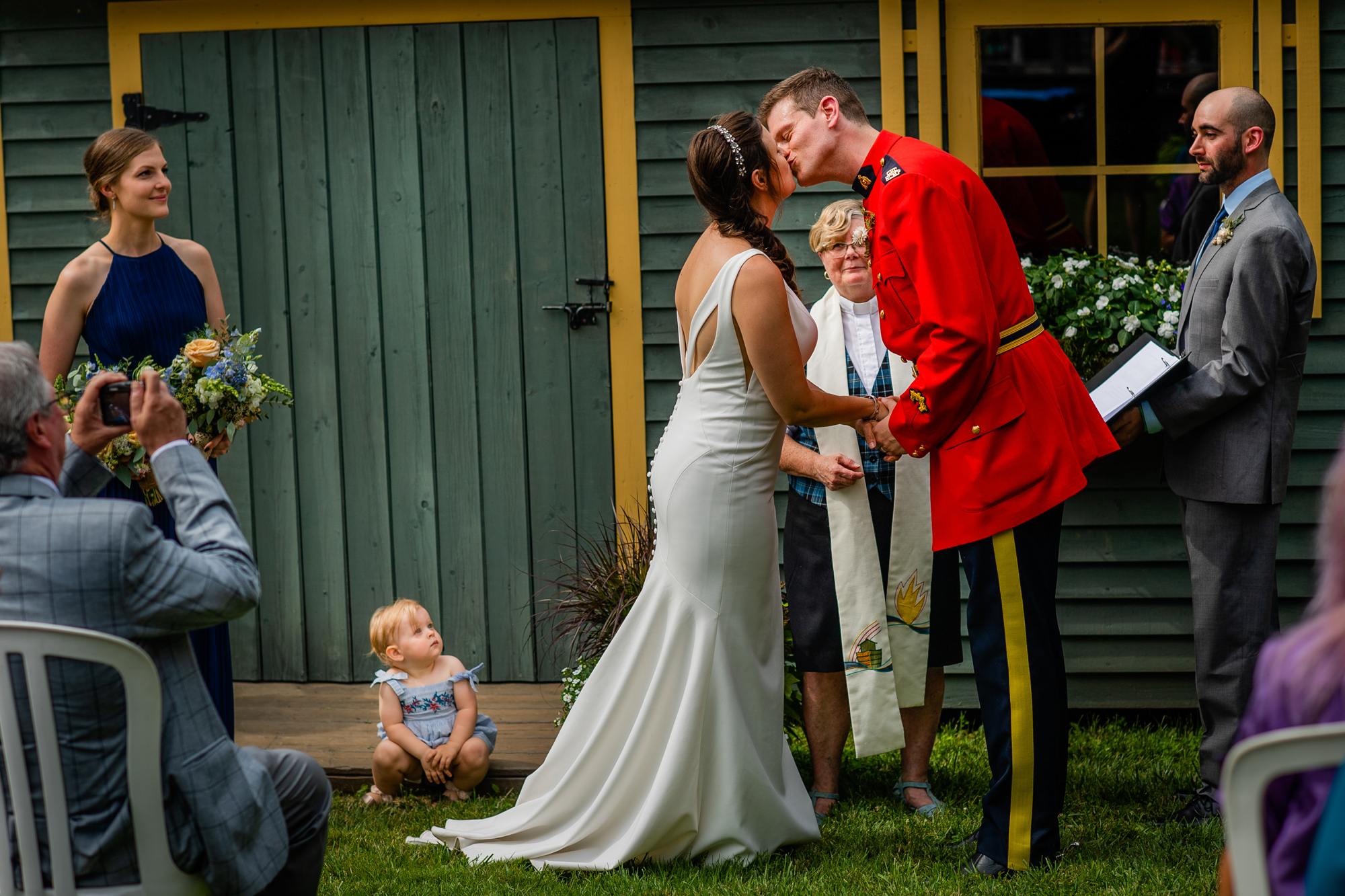 Mountie kisses bride - photo by Cooked Photography