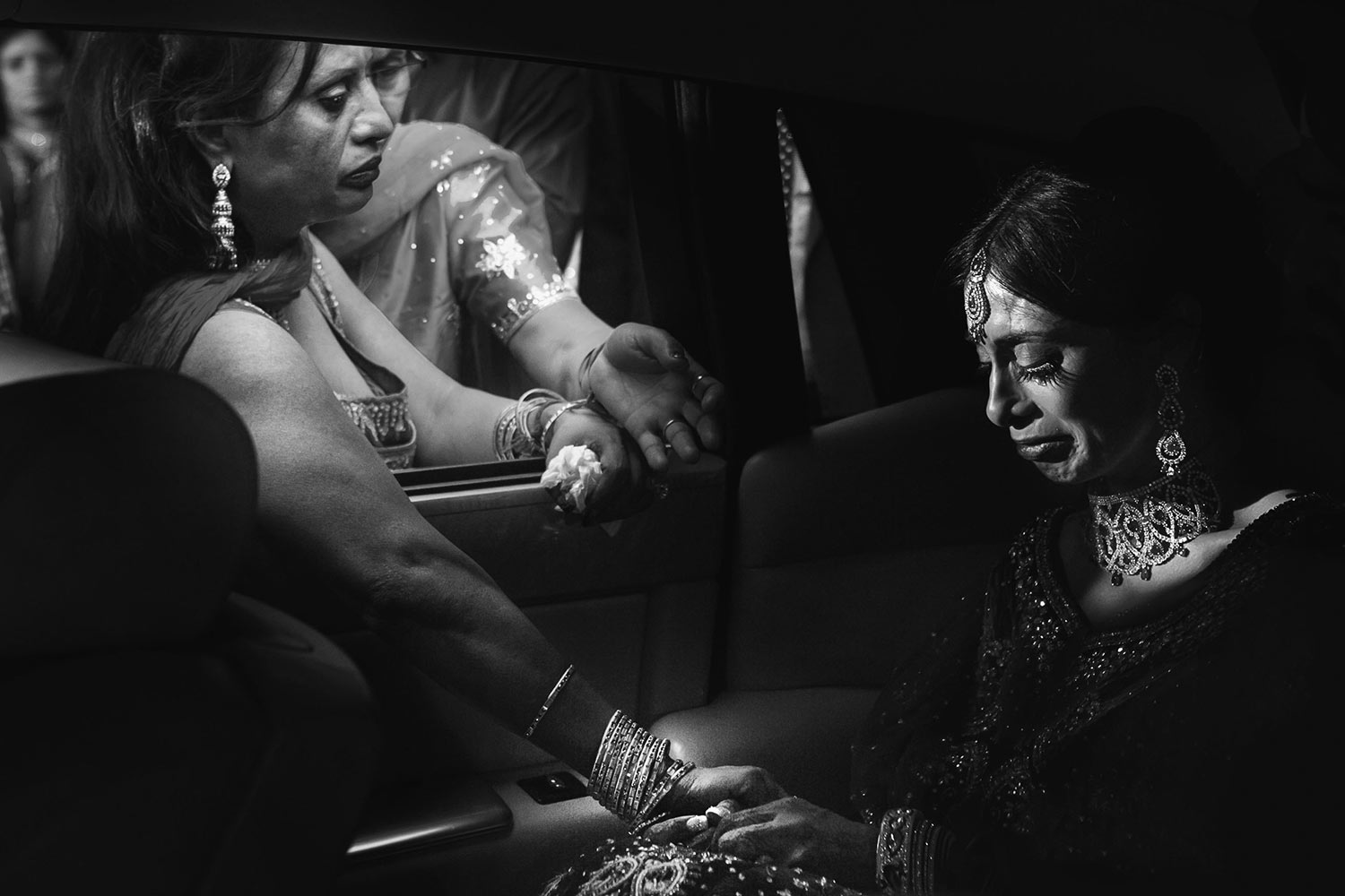 Tearful Indian bride as family bids farewell in limo, by Callaway Gable