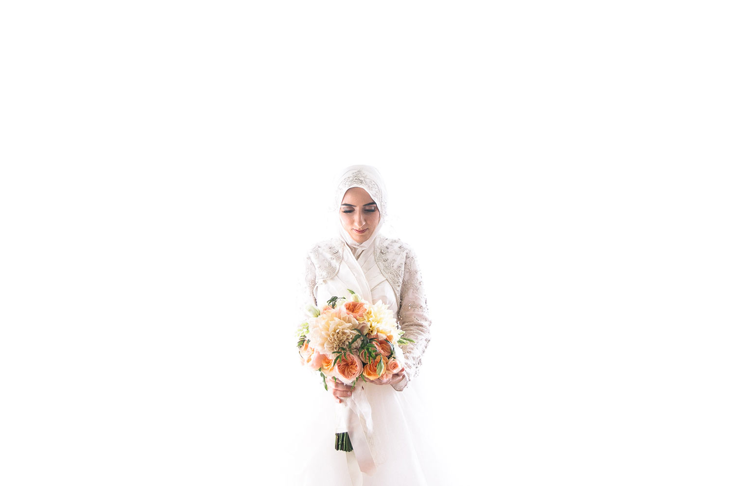 High key portrait of Muslim bride in head scarf with orange and coral bouquet, by Calloway Gable