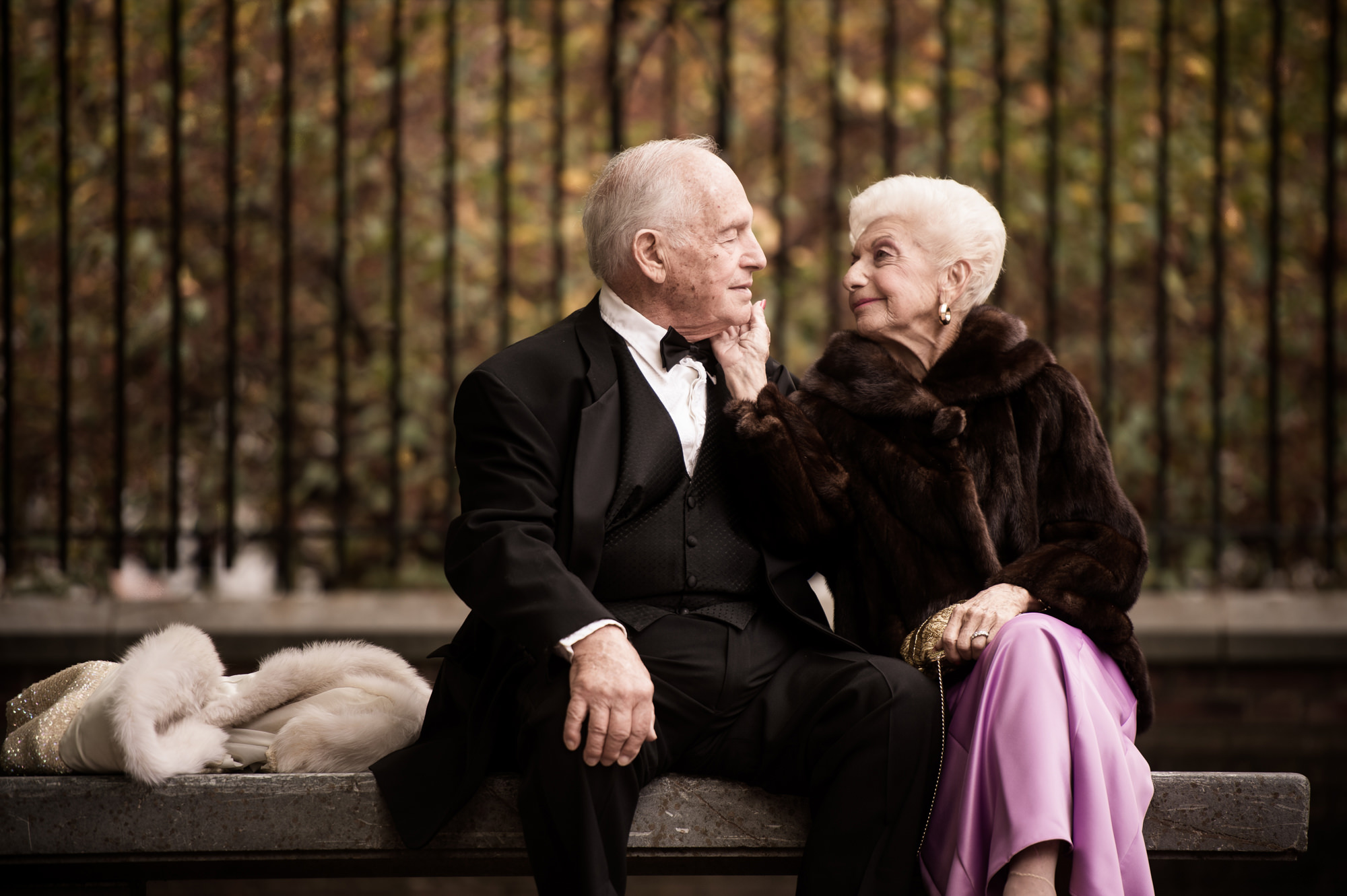 Older bride and groom share a tender moment at the park, by Cliff Mautner