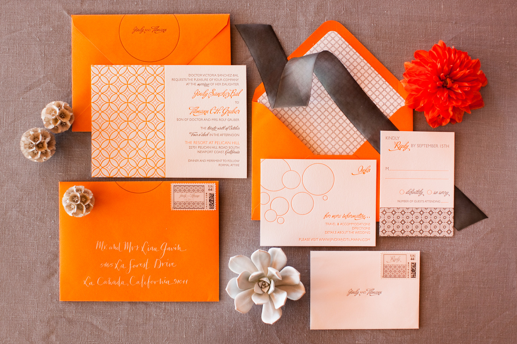 Modern organe wedding invitations with geometric designs - photo by John and Joseph Photography