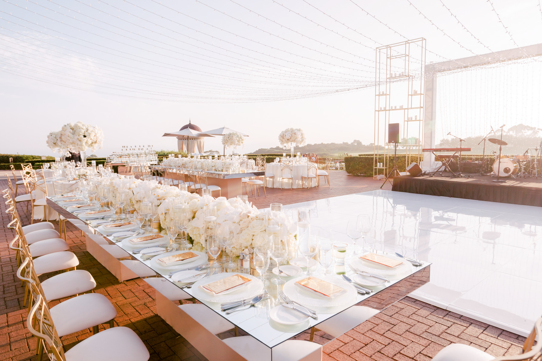 Reception at Pelican Hill Newport with white wedding decor - photo by John and Joseph Photography