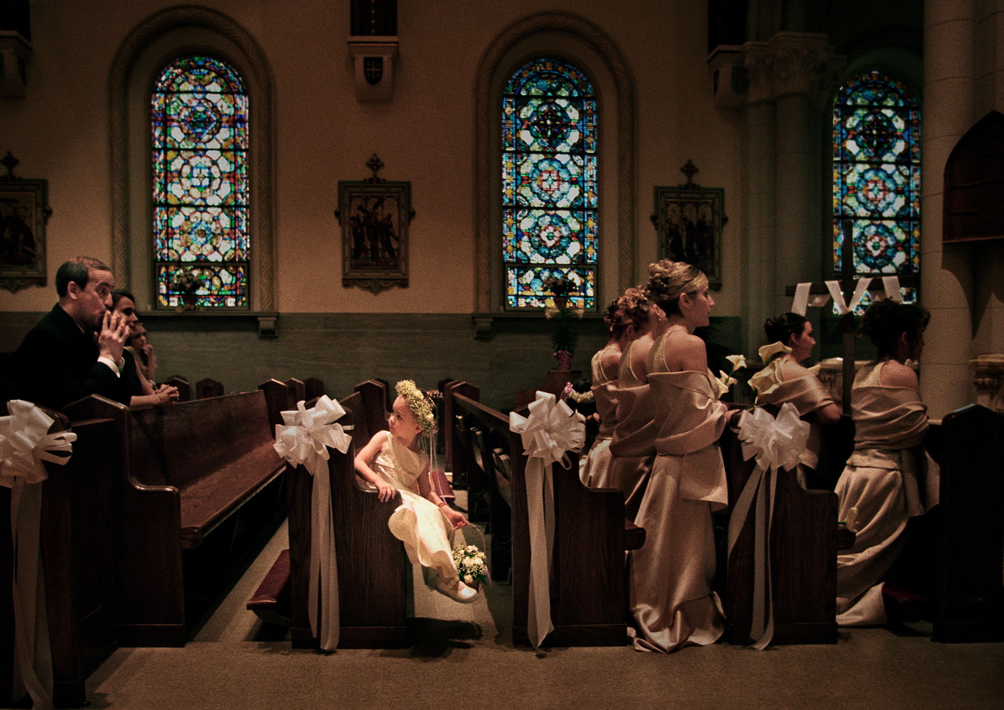 Parent shushing flower girl at church wedding photo by Cliff Mautner