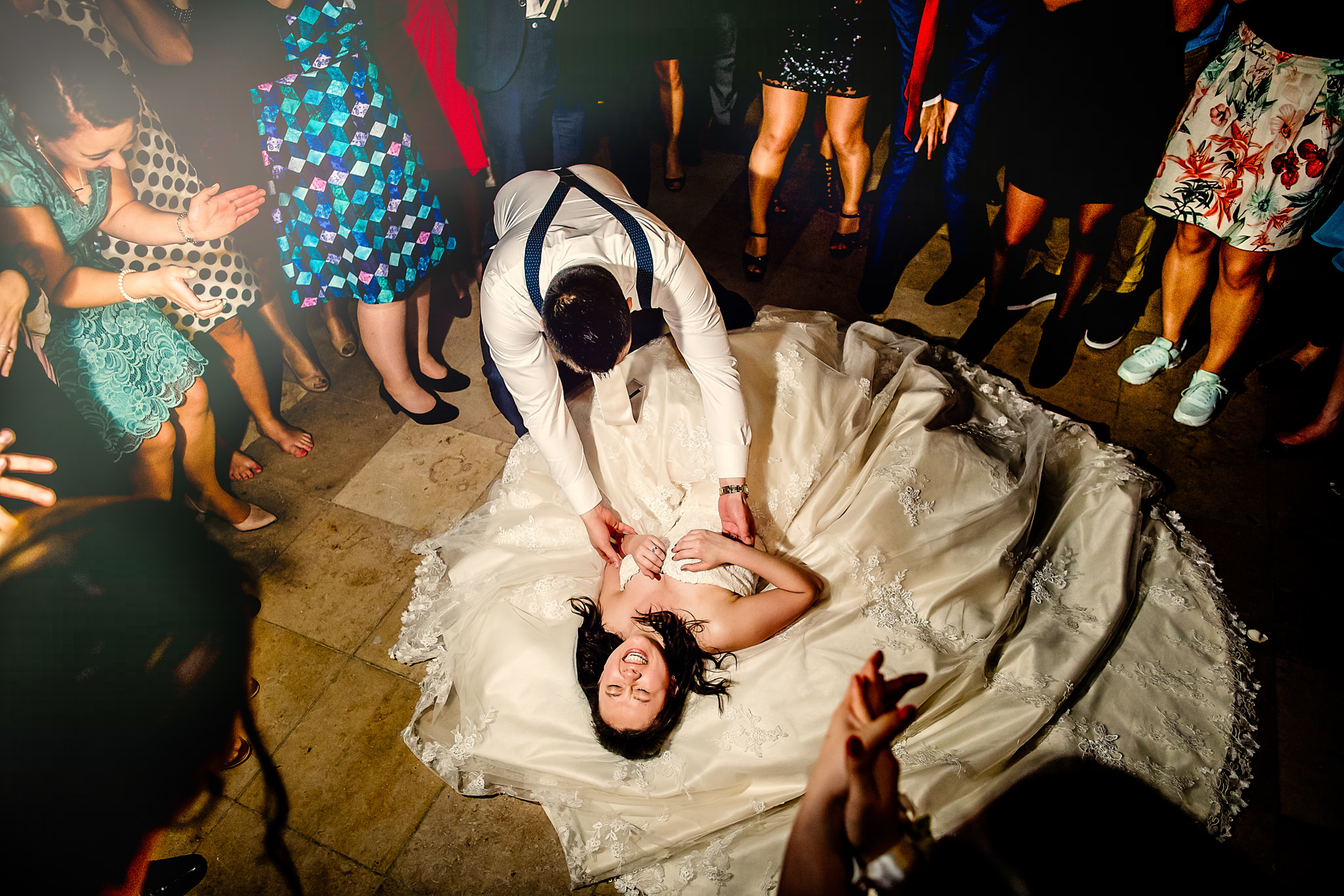 Party time photo of bride on floor by Eppel Photography Netherlands