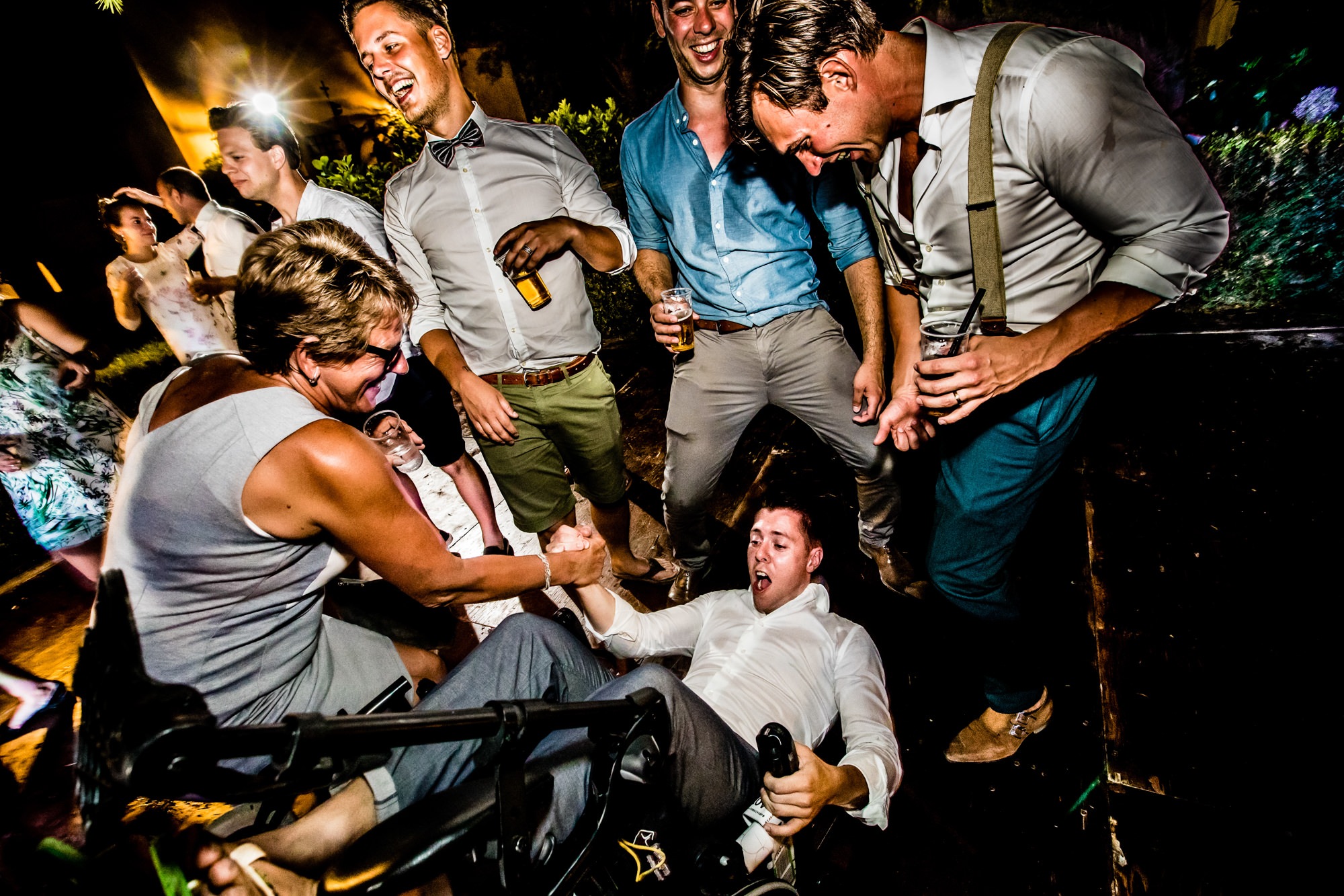 party photo of guest falling of his chair by Eppel photography