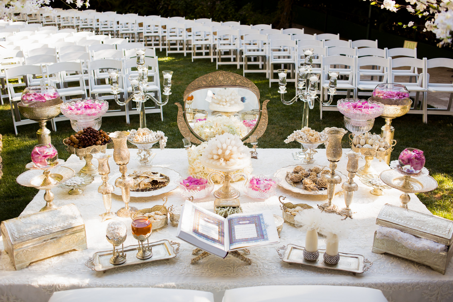 Persian gold and pink ceremony table - photo by John and Joseph