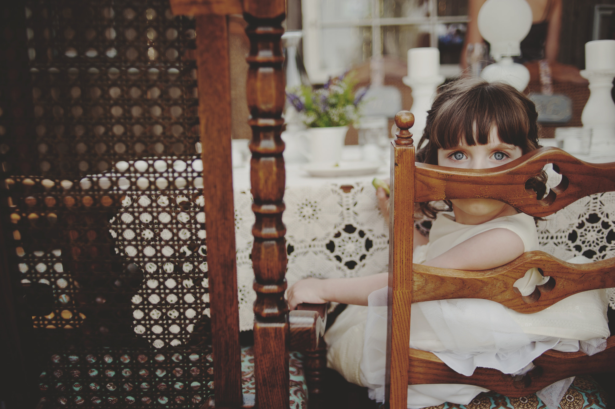 Portrait of little girl at dining table - photo by Kristen Marie Parker