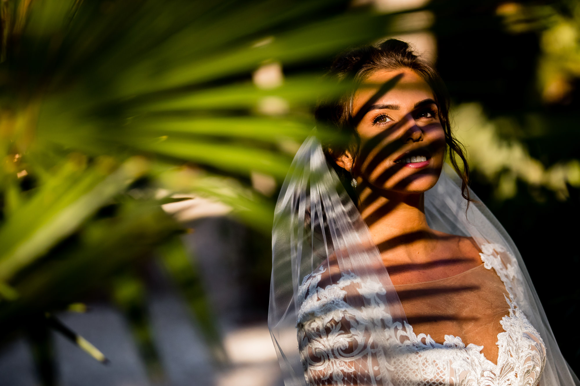 Portrait of bride with shadow of palm frond by Eppel photography