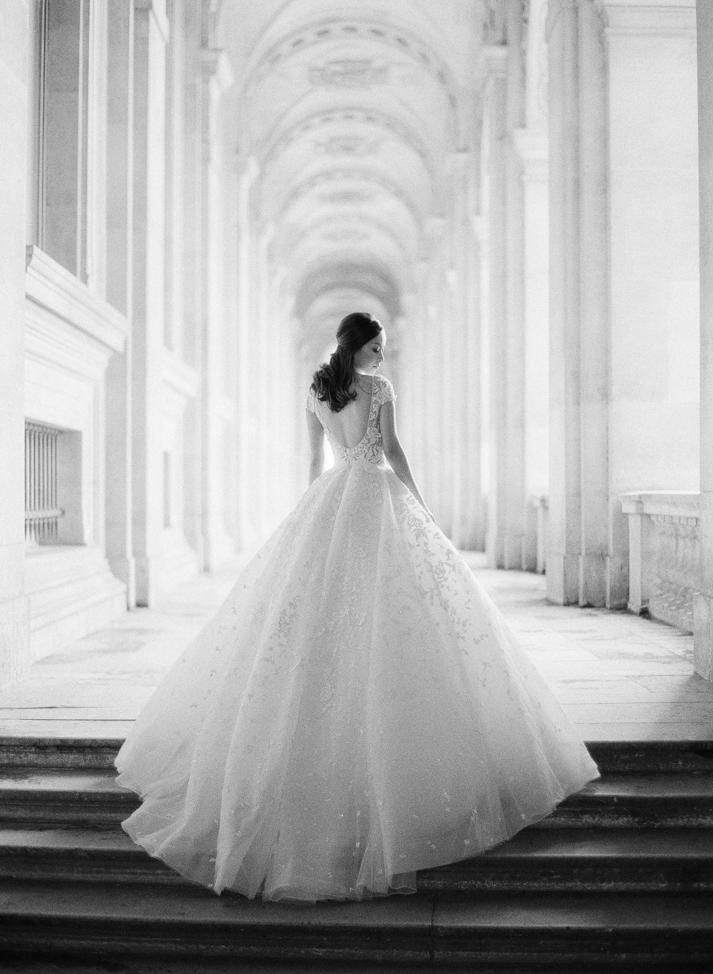 Bride in romantic long ballroom in Parisian collonade - Greg Finck Photography
