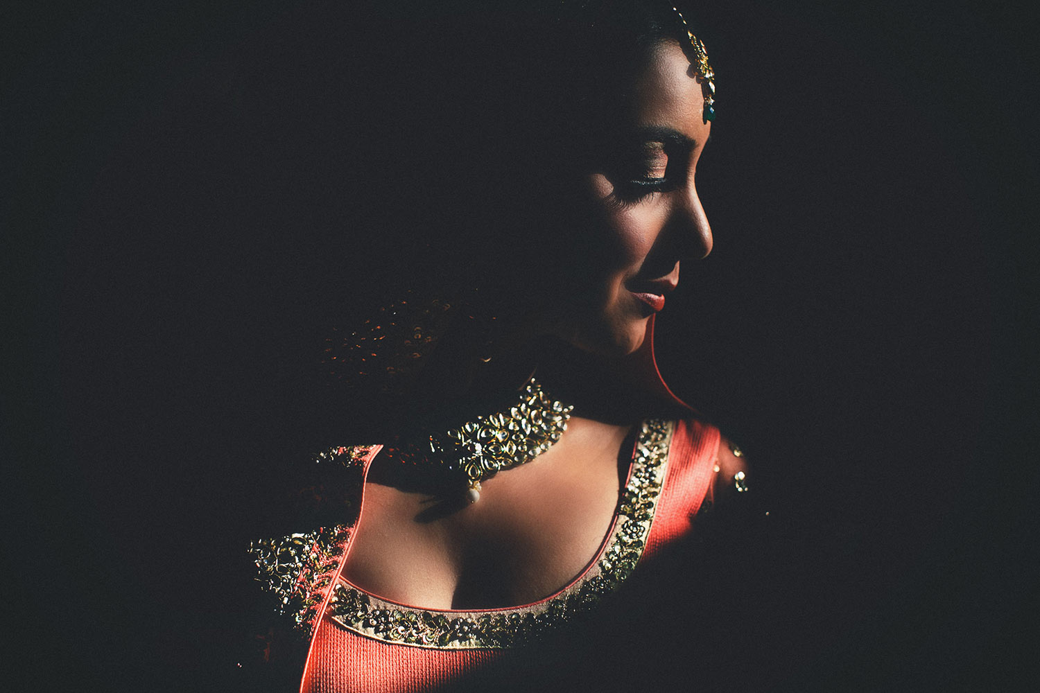 Low key profile of Indian bride in beautiful light, by Callaway Gable