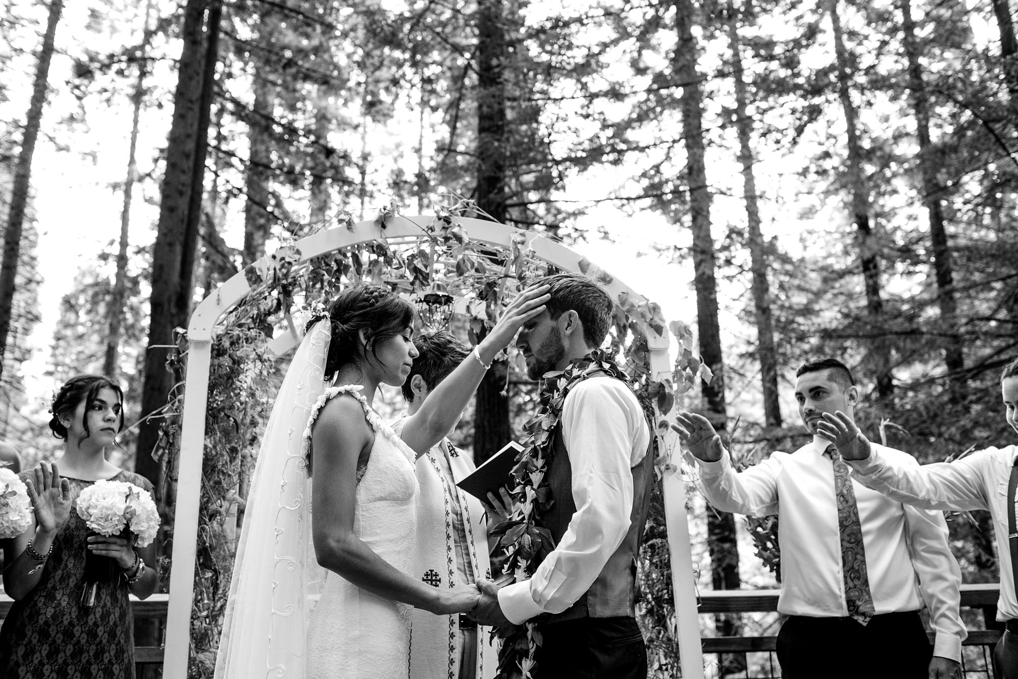 Praying for groom during ceremony - Jessica Hill Photography