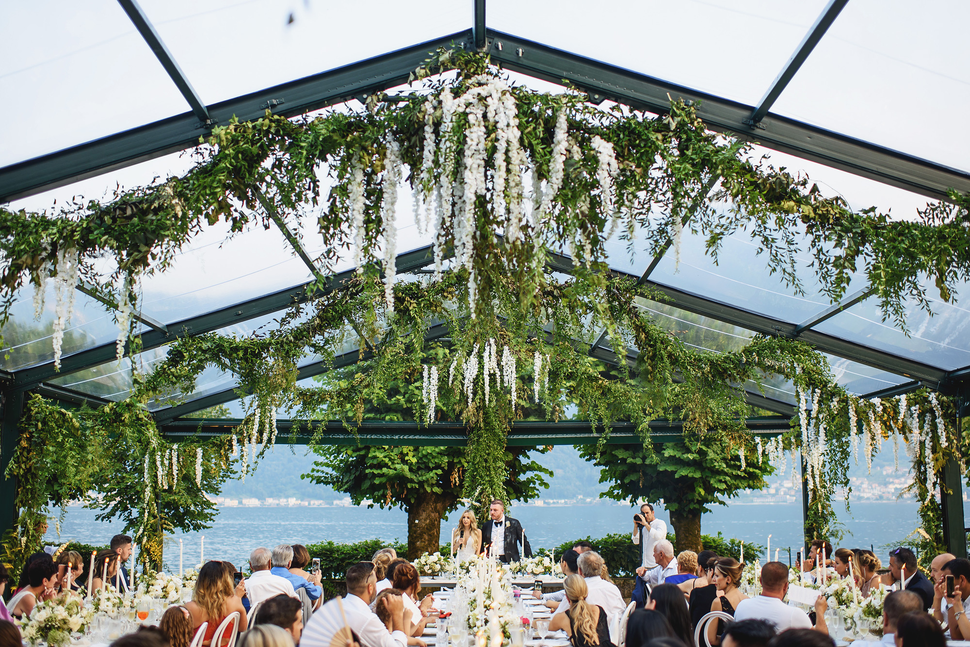 Floral and greenery canopy at Lake Como reception - photo by Ross Harvey